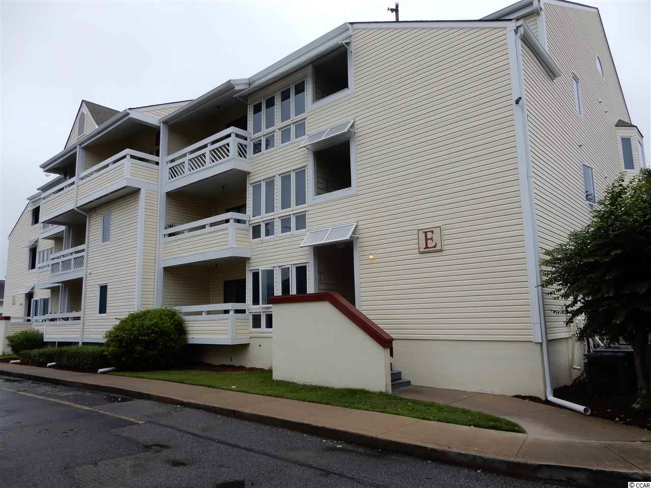 This cute and cozy top floor unit is waiting for you.  Owners have kept this home in excellent condition.  Enjoy your enclosed sun room overlooking the pool.  A short drive to the beach in your golf cart or car.  Pool and tennis courts are there for you to also enjoy.  Close to all the beach has to offer.