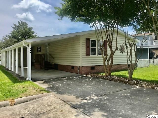 ABSOLUTELY BEAUTIFUL MAINTAINED 3 BEDROOM HOME ON THE LAKE!!   Not many extended 3 bedroom homes OVERLOOKING the Twin Lakes with a big lot in OSV!    Many updates have been done to this home over sellers ownership. Replacement windows hurricane grade, roof 2017, Sea Wall 2018, Interior Painting,  Hvac system, pipes have been wrapped.  Over all maintenance of this property inside and out has been exceptional.   ALL UPSCALE furniture and decor included in this sale Ethan Allen, Lazy Boy and TI interior designs.