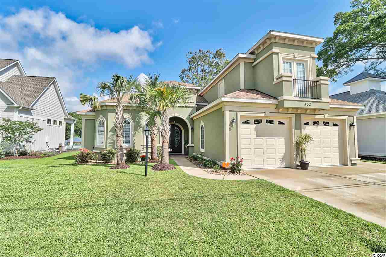 "If you are looking for a gorgeous, custom built, mediterranean home with an open floor plan situated perfectly on the intracoastal waterway with no HOA, then look no further.    This 3br/3ba boasts an open floor plan, gorgeous details, incredible outdoor space, and is in absolute mint condition.     From the moment you enter the grand foyer, you are met with beautiful porcelain tile running throughout the entire home.   As you make your way into the main area of 352 Waterside Drive, you begin to see the waterway views that await you and the details that make up this home.   The spacious great room offers coffered ceilings, a gas fireplace, custom built-ins with marble, and opens nicely to the rest of the home.    Your large kitchen boasts gorgeous waterway views, stainless steel appliances, marble countertops, tons of cabinet space and counter space, double oven, 36"" radiant surface range with stainless steel hood, and an oversized walk-in pantry with custom shelving.     As you make your way from the kitchen to the Billiards room (or the additional living room), you will notice the back of the home offers tons of windows which shows off your incredible outdoor space and views.  Walk onto your covered Lanai and enjoy plenty of private covered space, outdoor kitchen, room for dining and entertaining, all while enjoying views of the ICW, your own saltwater pool, and a conservation area located directly across the ICW from you.    This lot offers a spacious fenced in yard for your family to enjoy.   If you are a boater, you will enjoy your own private dock with a 10,000 lb covered boat lift with a deck, and you can also use the private, neighborhood only, gated concrete boat ramp.    This three bedroom home includes each bedroom offering it's own bath.   The master bedroom has great views, large his and her walk-in closets, tray ceiling, surround sound, and one of the most incredible master baths you will find here at the beach(make sure you check out the pictures).    This master bathroom offers separate sinks, vanity, huge walk-in shower with three shower heads, marble counters, and soft close drawers and cabinets.    Bedroom #2 is tucked away on the opposite side of the home for total privacy.    Bedroom #3 is located upstairs with it's own full bathroom and is perfect for guests coming to visit.    If you are someone looking to be able to work from home while you are away, there is a dedicated office perfect for your time here at the beach.    There are so many details to mention, but some of the other great features include:   Surround sound, both guest bathrooms have porcelain tile enclosures, large laundry room, on demand gas water heater, soft close doors and drawers in the kitchen with custom built cabinetry, three zone irrigation system, oversized garage with golf cart garage door, and a large walk-in attic.   This home is located approximately 3 miles to the beach, and only about 5 minutes from the Myrtle Beach International Airport and Market Common.    If you are looking for the perfect place to call home here at the beach, this is it."