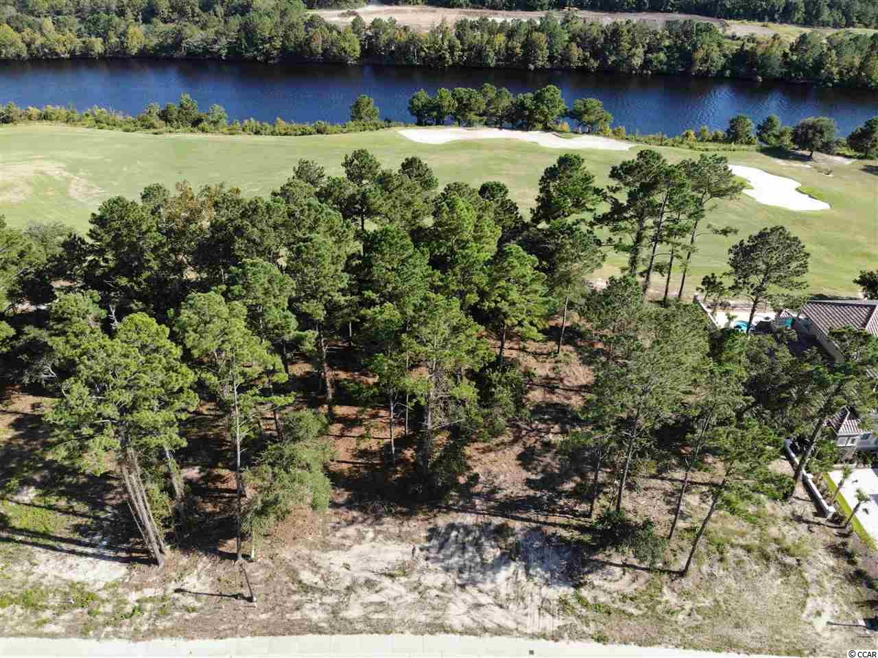 Spectacular views of the ICW and Resort Course at Grande Dunes from this high lot in Villa Venezia. Watch the boats go by and the sunrise from your backyard! One of the only properties in Grande Dunes with golf and waterway views. Don't miss out! No timeframe to build and chose your own builder. This property is located in South Carolina's premier coastal community in Myrtle Beach; Grande Dunes.  Stretching from the Ocean to the Carolina Bays Preserve, this 2200 acre development is amenity-rich and filled with lifestyle opportunities unrivaled in the market.  Owners at Grande Dunes enjoy a 25,000 square foot Ocean Club that boasts exquisite dining, oceanfront pools with food & beverage service, along with meeting rooms and fun activities.  Additionally, the community has two 18-hole golf courses along with several on-site restaurants, deep water marina, Har-tru tennis facility and miles or biking/walking trails!  Please visit our sales gallery located in Grande Dunes Marketplace next to Lowes Foods to learn more about this amazing community you can call home.