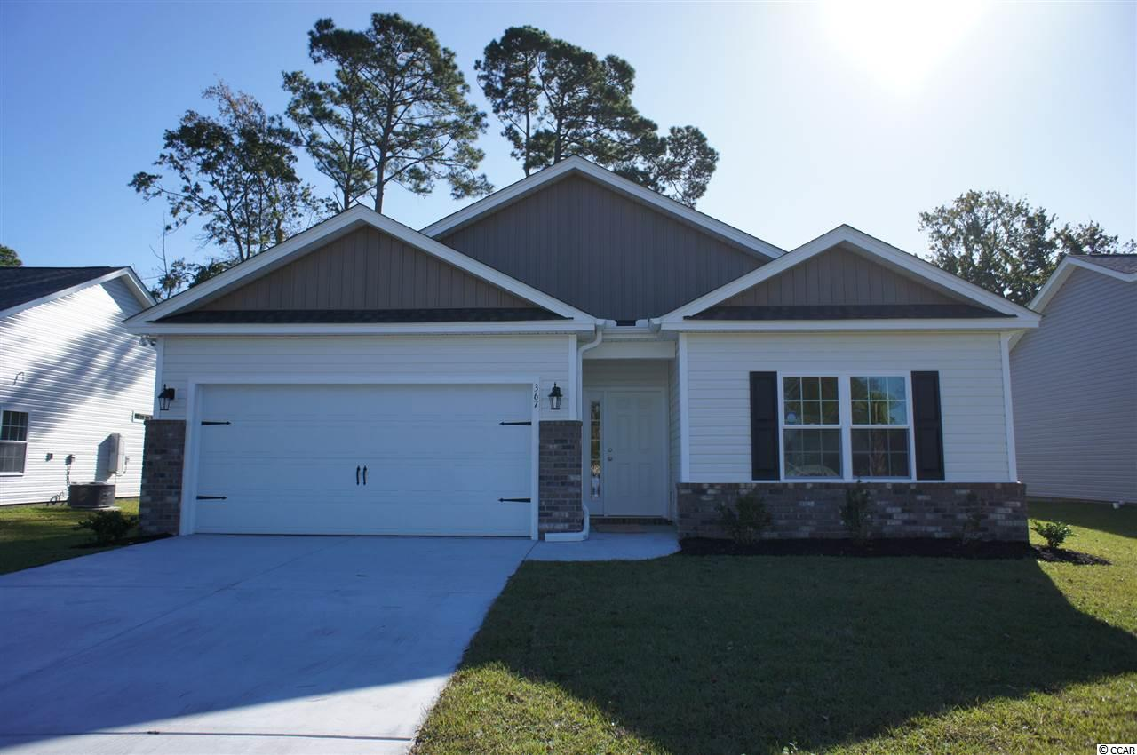 Beautiful Topsail floor plan under construction in Ocean Palms. This terrific open floor plan, 3 bedroom, 2 full bath home will have upgraded waterproof laminate flooring under the soaring vaulted ceiling in the family room, kitchen and dining area and comfortable carpet in bedrooms. Stainless appliances, staggered height Shaker-style white painted cabinetry and a gorgeous granite kitchen island combine to give the kitchen the wow factor you're looking for. A French door in the dining area leads to a large covered porch with a patio. The spacious master retreat features a tray ceiling, long vanity with double sinks, an oversized walk-in shower, plenty of storage in the cabinetry plus two huge walk-in closets. Two additional bedrooms and a bath are tucked off on their own private hallway, for privacy.  All of the homes in Ocean Palms come standard with the luxury of Natural Gas (tankless water heater, gas heat, and gas range).   The garage is completely trimmed and painted. Ocean Palms is conveniently located near shopping, restaurants, schools and world class medical offices and hospitals, and a short golf cart ride to Surfside Beach's gorgeous beach and the Atlantic Ocean. Other floor plans and inventory homes may be available. Community Pool and Cabana Coming Soon! Photos are of a completed, similar home and may have different features.