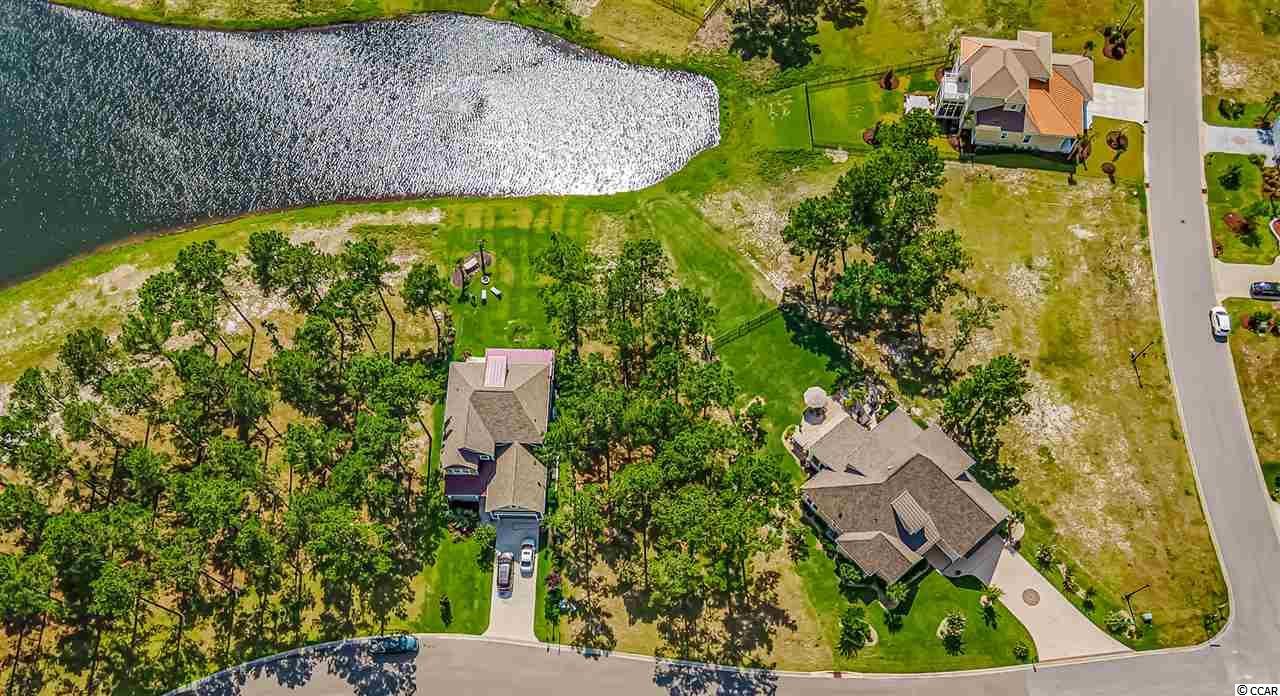 Great sized water front home site in the award winning Carolina Forest community of Waterbridge. This gated community offers two gated entrances, a large village-style clubhouse, and the largest residential swimming pool in South Carolina! With resort-style amenities such as, a 24 hour Fitness Center, tennis, pickleball, basketball, sand volleyball, and bocce ball courts. A 60 plus acre lake located in the heart of Waterbridge, perfect for kayaking, row boating, and canoeing complete with boat launch!
