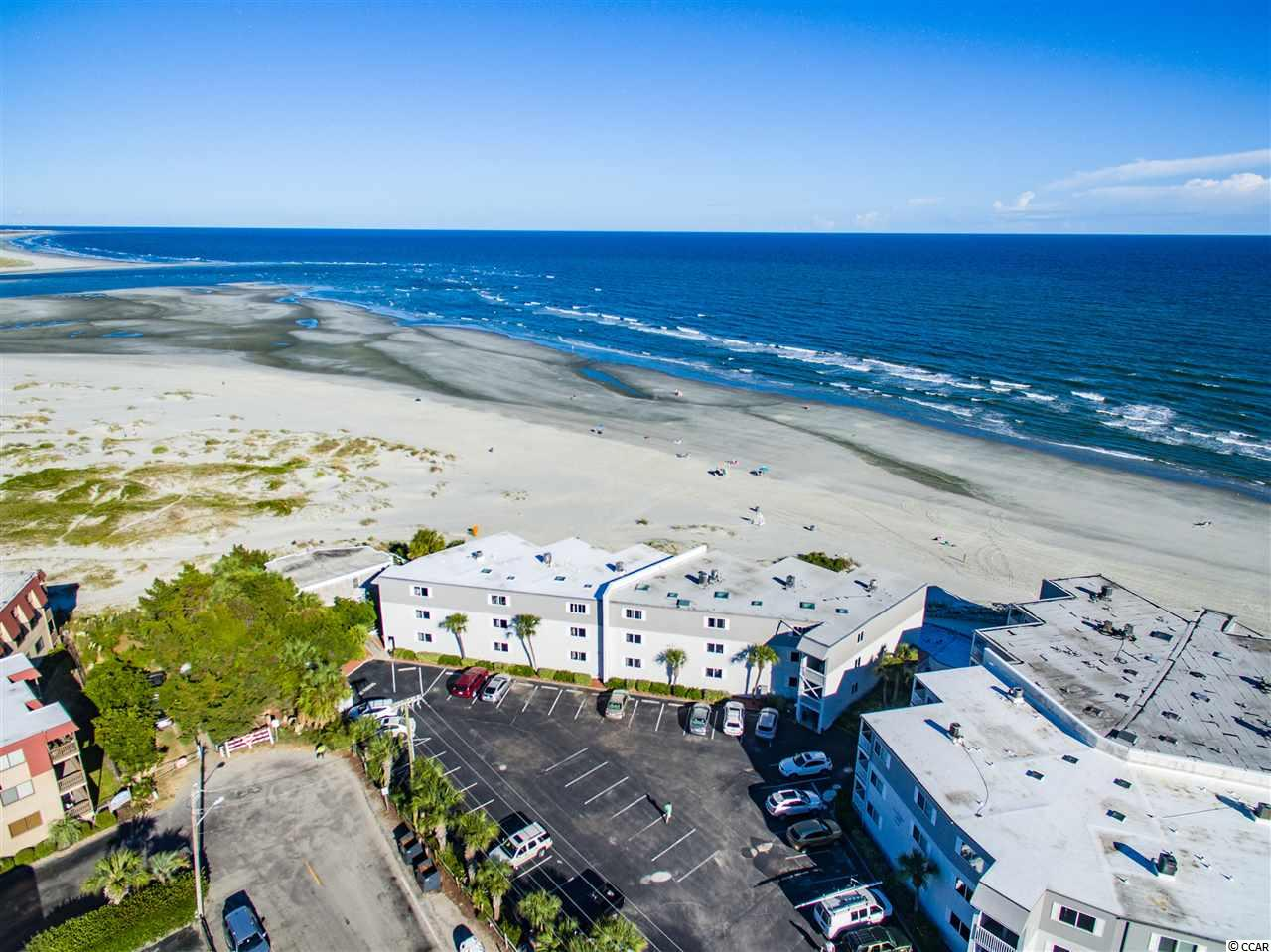 Ocean View Villas in Cherry Grove!  Very rare opportunity. This 2br/2b condo is located at the point in Cherry Grove and has unobstructed view of the ocean, inlet and Waities Island.  Views found nowhere else in the Grand Strand.  The condo features laminate floors, updated kitchen and bathrooms and is being sold fully furnished. The complex features a private gated parking area and an oceanfront pool.  This section of the beach has wide beaches, access to the inlet for fishing, kayaking, and crabbing.  Don't wait till this is a missed opportunity!
