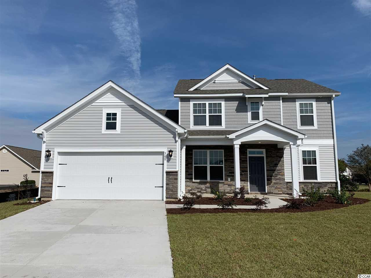 "This lovely Natural Gas ""Millbrook"" home is conveniently located in Belle Mer; the best kept secret on the south-end between Myrtle Beach and Murrells Inlet just off 17-Bypass, across from South Strand Commons, just a bicycle ride to the public beach accesses in Surfside Beach. This ""Millbrook"" boasts upgraded included features, Energy Star Certification for lower utility costs and a more restful home, an open concept floor plan, and a fresh new design. The generous open Kitchen features crisp white Shaker style Kitchen cabinets, a ""Light Gray Glossy""Virtuvian - Subway tile backsplash, granite counter tops, and an Island with 3 Staunton glass pendant lights that also add to the coastal flair. All Stainless Steel Whirlpool Kitchen appliances including Refrigerator, washer dryer, whole house window blinds and gutters included. Master bath features glass enclosed tiled walk-in spa shower with two shower heads. All living areas of this home include easy-maintenance Mohawk REV Wood flooring. All baths and the laundry room include tile flooring. This ""Millbrook"" offers an office/ flex room, 2.5 baths, 3 bedrooms upstairs, and the owner's suite downstairs. The great room ceiling is open to the 2nd floor creating an incredible WOW factor when you enter this spacious, well appointed, easy-living, low maintenance home. The Belle Mer community includes amenities galore: pool, clubhouse,exercise room, sidewalks, and fishing-canoeing lakes. The interior home photos are of a similar decorated Millbrook model home."