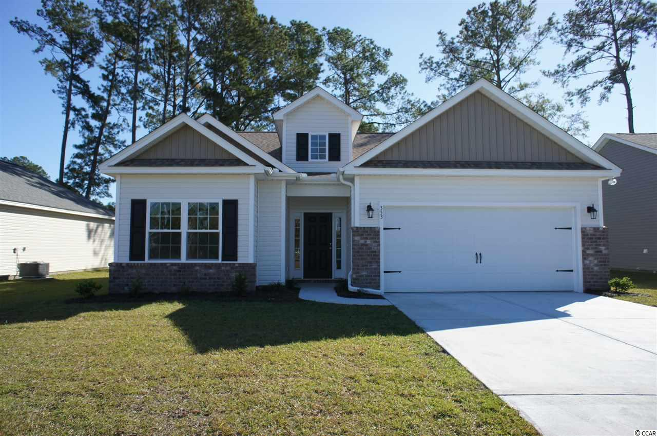 Beautiful Hatteras floor plan in the new Ocean Palms community. This terrific open floor plan, 3 bedroom, 2 full bath home has a live dormer with a high ceiling and vault over the great room and wood-look waterproof laminate flooring in the great room, kitchen and dining room, under the soaring vaulted ceiling and comfortable carpet in the bedrooms. Stainless appliances, quartz counters, staggered-height grey painted Shaker-style cabinetry and a convenient breakfast bar combine to give you the wow factor you're looking for, and abundant recessed lighting plus two large windows in the adjacent dining area and pendant lights above the kitchen island flood the room with light. There's even a large walk-in pantry. A French door in the great room leads to the covered rear porch and the large separate patio beyond. The spacious master retreat features a long vanity, an oversized walk-in shower, plenty of storage in the linen closet and a huge walk-in closet, plus a tray ceiling. Two additional bedrooms and a full bath are tucked off on their own hallway, for privacy.  All of the homes in Ocean Palms come standard with the luxury of natural gas (tankless water heater, gas heat, and gas range). The two car garage is completely trimmed and painted, and a floored attic storage space is accessed by drop-down stairs. Ocean Palms is conveniently located near shopping, restaurants, schools and world class medical offices and hospitals, and only a short golf cart ride to Surfside Beach's gorgeous beach and the beautiful Atlantic Ocean. Other floor plans and inventory homes may be available, and CUSTOMIZATION OF FLOOR PLANS IS POSSIBLE!!! Community Pool and Cabana Coming Soon! Photos are of a completed, similar home and may have different features.