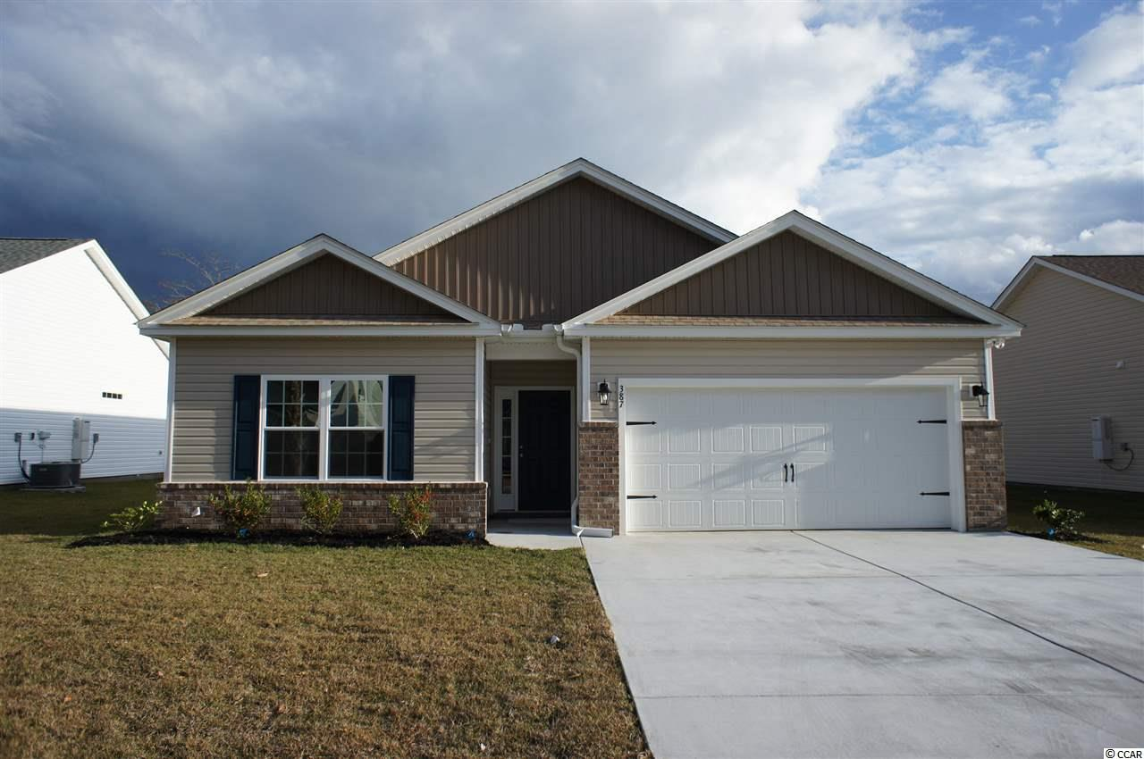 Beautiful Topsail floor plan in the new Ocean Palms community. Purchase early and choose all of your own colors! This terrific open floor plan home will have wood-look sheet vinyl flooring throughout. Stainless appliances, staggered-height birch cabinetry, a corner pantry and a beautiful granite work island/breakfast bar combine to give the kitchen the wow factor you're looking for, and the double windows in the dining area flood the room with light. A French door from the dining room leads to a covered porch and large patio. The spacious master retreat features a tray ceiling, oversized walk-in shower, long vanity with double sinks, plenty of storage in the cabinetry, plus two huge walk-in closets. Two additional bedrooms and a bath are tucked off on their own private hallway, for privacy. All of the homes in Ocean Palms come standard with the luxury of natural gas (tankless water heater, gas heat, and gas range). The garage is completely trimmed and painted, with floored attic space accessed by drop-down stairs. Ocean Palms is conveniently located near shopping, restaurants, schools and world class medical offices and hospitals, and is only a short golf cart ride to Surfside Beach's gorgeous beach and the Atlantic Ocean. Other floor plans and inventory homes may be available, and CUSTOMIZATION OF PLANS IS POSSIBLE!!! Community Pool and Cabana Coming Soon! Photos are of a completed, similar home and may have different features.