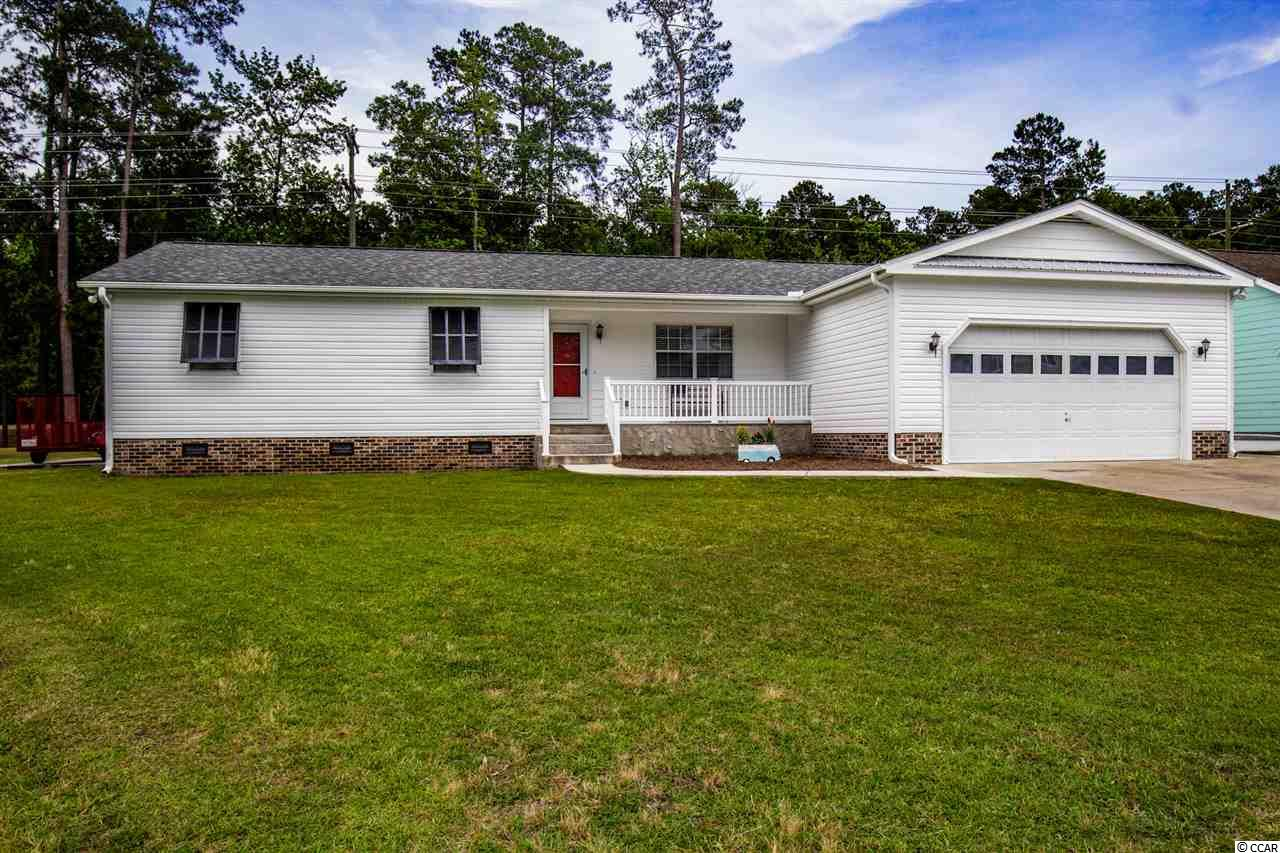 RARE FIND!!! Beautiful, one of a kind home, located on a HALF ACRE lot in Myrtle Beach is waiting on you! Bradford Creek is a small community with No HOA. It is conveniently located off of Hwy 544 and minutes from beaches, neighboring towns, CCU, and all attractions. This home features upgraded flooring throughout the house, 3 separate living spaces, formal dining area, upgraded kitchen, laundry room, and so much more. The complete renovated kitchen features all wood cabinets, raised panel doors, soft/ slow close hinges, under mount lighting, and a full sized pantry. The master bedroom has a beautiful 5 ft shower with rainfall head and two separate walk in closets one of them being 9x6. The Oversized Garage currently has 3 cars inside with built in cabinetry, sink with hot and cold water, and cable tv hook up. Outside of the home you have 2 attached storage closets 4x10 and 7x9 and a detached storage building that is 15x15. THIS HOME SITS HIGH AND DRY! NEVER FLOODED!  Don't let this deal pass you by!