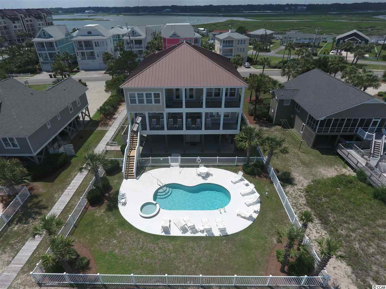 "Looking to channel your inner ""Sea Spirit?""  Look no further as this beautiful beach home consists of 8-bedrooms and 8.5 bathrooms.  It sits on one of the deepest and most protected (by sand dunes) 75' wide lots in Garden City Beach.  It has hardwood floors in the living areas and granite counter tops & stainless steel appliances in the kitchen.  Amenities such as a private heated pool, hot tub, double oceanfront porches, two very large living areas (upstairs living area has a pool table and kitchenette) all make it a very good rental property.  You are just a short walk from the ship store and fishing charters at Marlin Quay Marina and wonderful meals at Gulf Stream Cafe.  Contact the listing agent, or your Realtor, for more details or to set up a private showing."
