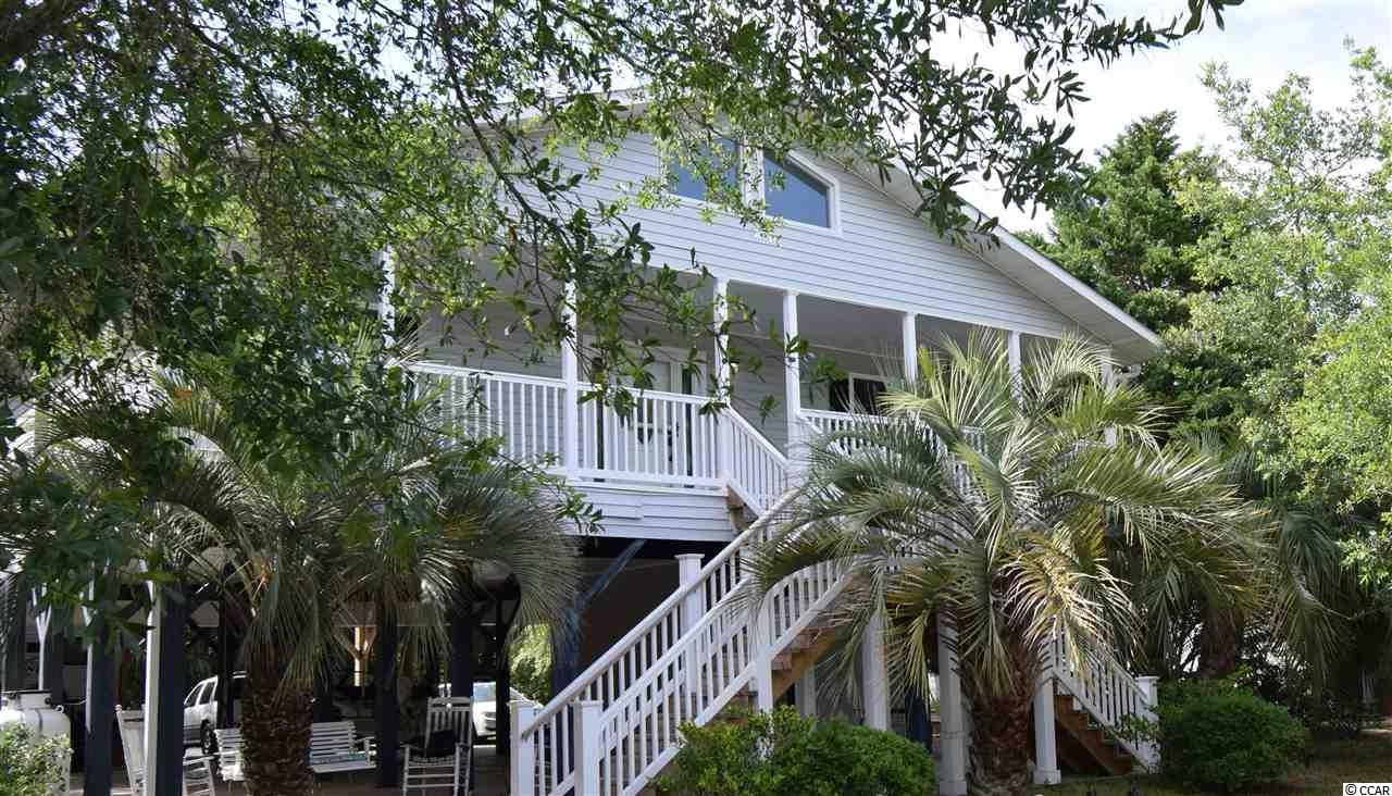 Listen to ocean waves from front porch - ONE BLOCK TO OCEAN while enjoying gentle breezes. CUSTOM BUILT home with 16 ft. vaulted ceilings & open-concept design. Completely renovated 2015-2019 to include high-end granite throughout, stainless appliances, premium Bamboo wood flooring with premium underlayment- elegant 24 inch porcelain tiles sparkle in gorgeous 20x16 custom kitchen including custom cabinetry with soft-close, dove-tailed drawers, glass doors, slide out drawers & spice rack, etc!  See through beautiful French doors to multi-purpose room where children can play, watch tv, eat, or use as a workout room, etc.  Enjoy lunch on the private rear balcony!  Large Master suite with walk-in closet, high-end Italian tiles in baths, hybrid hot water heater, custom HVAC, newer roof and siding, trex decking, vinyl railing, well-insulated propane gas fireplace, high-end Pella windows, & recessed lighting.  Loft is a perfect reading nook, play area for kids, extra storage,etc!  Enjoy spacious entertainment/parking below home where you can grill, picnic, relax in a hammock, play table tennis, swing, visit, park your boat or vehicles ...the possibilities are endless!  Home has large storage beneath home with hot/cold showers behind storage enabling you to create a great outdoor kitchen if desired!  Lot has been measured and wired for a 15x30 pool behind home.  This is your opportunity to own a peaceful oasis in this Salt Life Paradise just steps from the sand and surf!