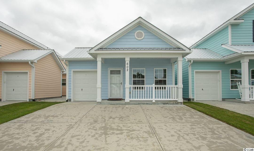 This is a rare single-story 3 bedroom/2 bath condo located in the coveted Cottages at 7th development in the heart of North Myrtle Beach.  Never rented - periodically used by owner as vacation home - this unit is in immaculate condition.  Master has large walk-in shower.  Two exits to the backyard/patio area with insulated storm doors.  Large and spacious attached storage unit in the back.  Cottages at 7th is conveniently located in North Myrtle Beach close to shopping, dining, and attractions - and just a short golf-cart ride to the beach!  This property won't last long - so schedule your showing today!