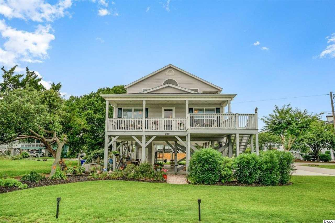 "Looking for the perfect beach home? ""Diamond by the Sea"" is it! Located on a large corner lot in the Floral Beach community of Surfside, this beautiful home has wonderful ocean views from the front and side porches, and the beach is only a short walk away. The versatile floor plan features two living areas with 3 bedrooms and 2 baths on the first level, and a 1 bedroom 1 bath mother-in-law suite/apartment on the second level that would also be great as a rental property. The main floor boasts vaulted ceilings, ceiling fans throughout, and tile floors in the spacious living room, dining area and gorgeous kitchen that features a breakfast bar , abundant cabinet space, granite countertops, tile backsplash and new black slate appliances. The master suite includes a walk- in closet and  bath with granite vanity top and tub/shower combination. There are two additional bedrooms with plenty of closet space and a second bath with granite vanity top and tub/shower combination.  All three bedrooms have luxury vinyl plank flooring . The front entrance to the first floor features an extended covered porch and sun deck area that are perfect for friends and family to gather and enjoy the view. There is also a  brick patio for grilling or just relaxing. The driveway and the covered parking under the house will accommodate 8+ vehicles. The fully enclosed storage is ideal for beach chairs, umbrellas, toys and bikes. The apartment upstairs has a private entrance and features an open floor plan with vaulted ceilings, a fully equipped kitchen with breakfast bar and dining area, large bedroom, bath with double sink vanity, tub/shower combination and direct access to the private covered porch from the living room or the bedroom. This unique home is in close proximity to the library, farmer's market, shopping, restaurants, golf courses and many attractions. Sort term rentals are allowed and there are no HOA fees. Residents enjoy many community benefits such as free beach parking, mosquito spraying and excellent public service from police and fire departments. Whether you are searching for a primary home, dream vacation getaway, or an investment property, this is a must see! Don't miss this wonderful opportunity!"