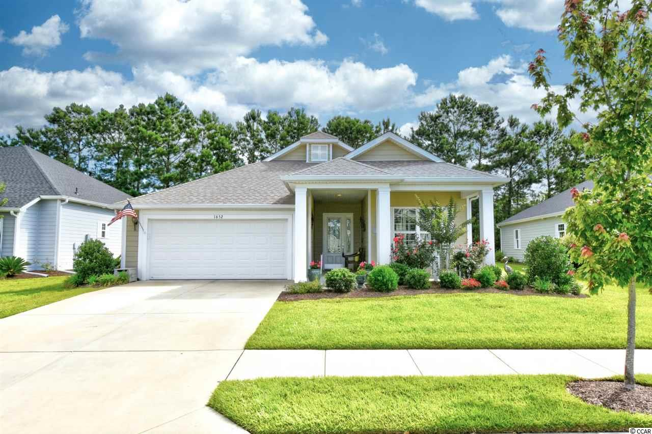 Welcome home to this meticulously maintained, 3 bedroom, 2 bathroom home in the active adult neighborhood, The Seasons at Prince Creek West. As you enter this home, you will feel the grand openness as tall, tray ceilings with crown and decorative molding, and luxurious wood flooring flow throughout. The kitchen is equipped with granite countertops, stainless steel appliances with a gas range, and includes a large breakfast nook and breakfast bar! You will have plenty of room for the whole family to gather in this spacious home. The master features double sink vanities, a large tiled walk in shower and huge walk in closets. Each bedroom includes a ceiling fan, plenty of closet space, and easy access to a bathroom. The office space can be used as an office, play room, formal dining room; the options are endless. Prince Creek offers the best amenities, including indoor and two outdoor pools, easy access to the wilderness park, tennis and pickleball courts, exercise center, library, clubhouse, and even a lifestyle director! HOA includes all the amenities, round the clock security, basic cable, internet and phone service, and more. Located near all of Murrells Inlet's famous seafood and dining experiences, the Marsh Walk of the Inlet, shopping, golf, and just a short drive to the beach. You won't want to miss this one! Schedule your showing today!