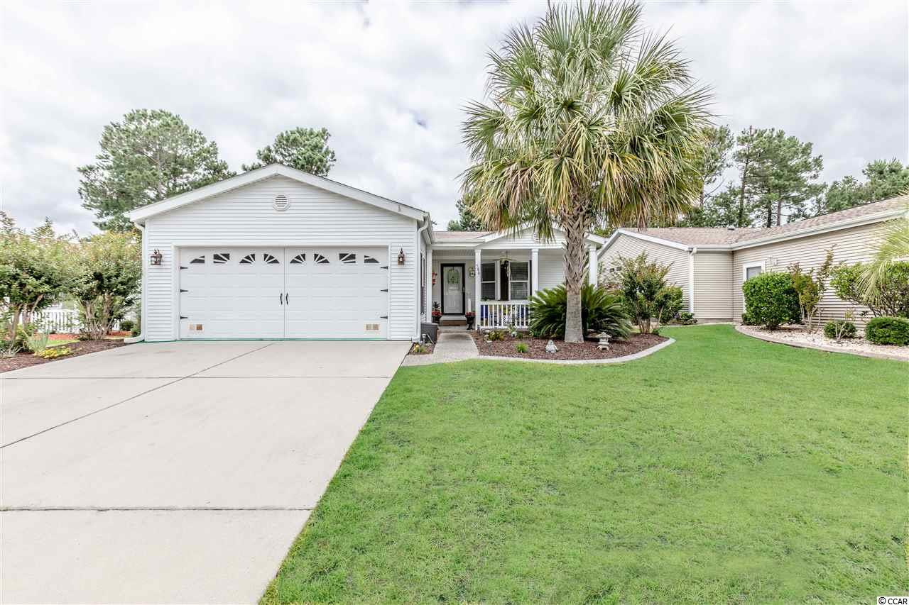 Beautiful, well maintained, Palm Harbor, Aberdeen Model in Lakeside Crossing community. This community is all about the lifestyle - if being active is your goal this is the home for you.  They have pools (indoor & out), hot-tubs (indoor & out), a fitness center, library, pool table, pub, card room, craft room, large lake with pedal boats available to homeowners, tennis & pickle-ball courts....there is so much to do. This home welcomes you with its front porch and has 3 BRs/2BAs, wood flooring in living, dining kitchen, hallway & boasts a large open floor plan, 2 car garage with specialty fan to keep it nice and cool. The kitchen features white, staggered height cabinets, granite counter, large corner pantry, an island & a breakfast bar with pendant lights. Master BR w/large walk-in closet, speakers in ceiling,  sitting area, and lots of light - Master Bath has soaking tub, walk-in shower w/glass doors and double sinks. Dining room is open to living room and kitchen with a built-in server, tray ceiling & lots of light. In the spacious living room you will find speakers for listening to your favorite music, ceiling fan, a sliding door taking you out to fenced in patio with awning and beautiful private back yard. Sit and have your coffee in the morning or entertain guests in the evening, its the perfect home for all that!