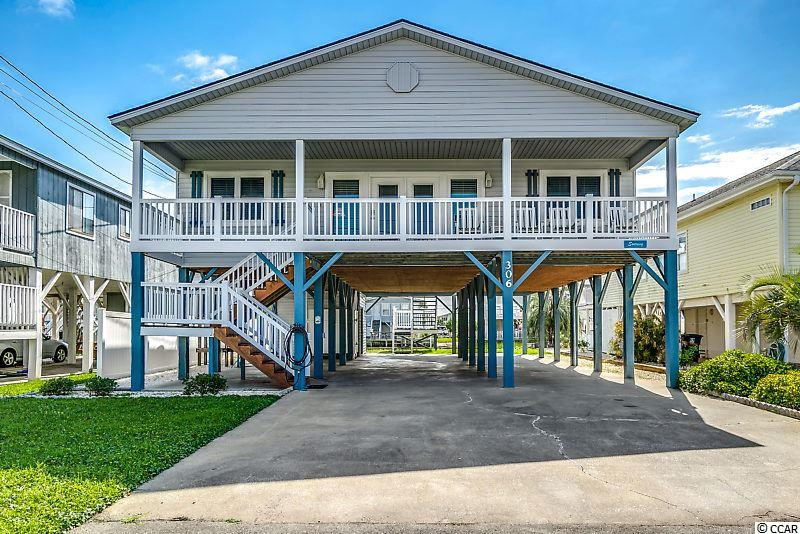"""Welcome to """"Soaring""""!  This meticulously maintained home has a prime waterfront location on the ever popular channels of Cherry Grove Beach.  This traditional stilted beach house floor plan features four bedrooms with two jack and jill baths.  Large combination living and dining room offer plenty of space for communal gatherings and family fun.  Spacious kitchen has plenty of cabinetry and counter space to prepare meals.  Just off of the kitchen is a large laundry space with a full size washer and dryer.  The property has been meticulously maintained and allows for low maintenance upkeep.  Upgrades are plentiful!!  Vinyl siding exterior with vinyl handrail and solid color deck boards.  Exterior doors are new as well as interior and exterior door hardware.  Vinyl replacement windows have been installed as well.  The roof is approximately ten years old.  This channel location offers easy access to the main channel and inlet.  The dredging project has increased navigability for this channel at low tide.  Want outdoor living at it's finest?  """"Soaring"""" offers a large covered rear porch overlooking the channel just off of the kitchen and dining space.  Or enjoy the ocean breeze from a rocker on the front porch.  And yes you CAN hear the ocean waves crash at high tide!  For convenience, a large outdoor enclosed shower is available on the ground floor with hot and cold outlets.  There is also plenty of space for your beach toys and equipment with a sizeable storage room on the ground floor.  Want to add a backyard pool?  There is a large backyard space with plenty of room to add your own.  This home will come fully furnished with all appliances, electronics and everything you see minus personal items.  Bring your suitcase and enjoy as your second home or use as a vacation rental investment!  All information is deemed reliable, buyer responsible for all verifications."""