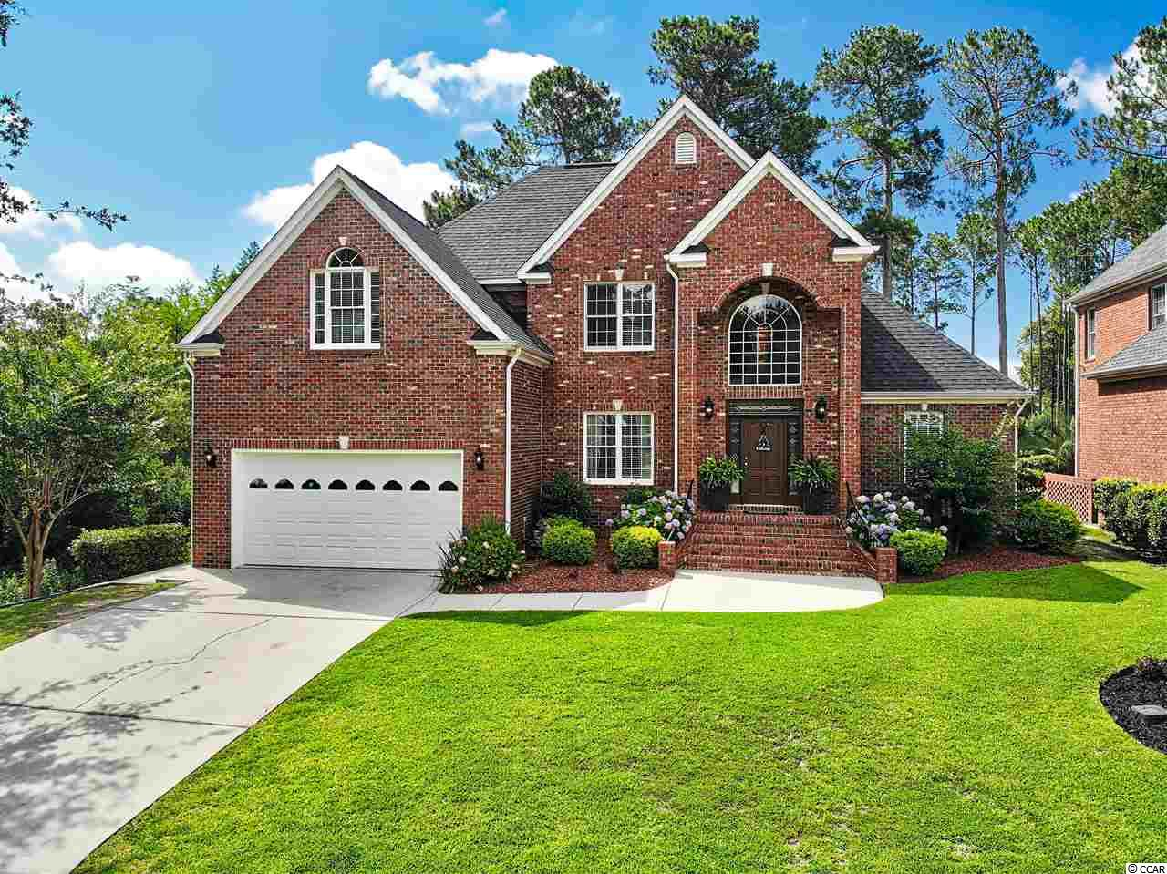 """This custom Builder's all brick home has the best of all worlds. Updates throughout that only a Builder's Home would have. Located at the very end of a quiet street, woods for privacy on one side of it, and you can relax under the covered pergola on the back porch and watch the golfers play the 13th hole on the prestigious River Hills Golf Course. Built-in Surround Sound throughout the house including outdoor speakers on the porch for entertaining. The 1st floor has 10 rooms. Step through the front door which is surrounded with beveled glass and into the open foyer which has a gorgeous modern one-of-kind chandelier hanging from the 18' high ceiling, a classic black & white staircase going upstairs, with a cat-walk looking down into the foyer on one side and the Living Room on the other side. Real ¾"""" Red Oak Hardwood floors throughout the 1st floor. The big Living Room has a huge 18' vaulted ceiling with a cozy gas/propane fireplace, plenty of windows with natural morning light pouring in (or keep it out with the 2"""" Plantation Shutters). Ceiling Fans in almost every room in the entire home. The formal Dining Room is beautifully decorated with custom paint & is off the Kitchen & Living Room, allowing an open concept for entertaining. The kitchen has custom Maple cabinets, granite counter tops, newer stainless-steel appliances incl a Convection Oven with 6 smooth surface elements, a Breakfast Bar & a Breakfast Nook. The large Master Bedroom has an ensuite bathroom with double vanities, walk-in shower & a relaxing oversized jetted soaker tub. The Master walk-in closet is very large and has built-in shelving. This floor plan provides a private hallway to a possible mother-in-law suite on the other end of the main floor which also has a full bathroom. This is currently being used as an office. Upstairs there are 6 more rooms including two bedrooms with great natural light. One of those bedrooms has the best view in the house overlooking the pond on the golf course. Jack-n"""