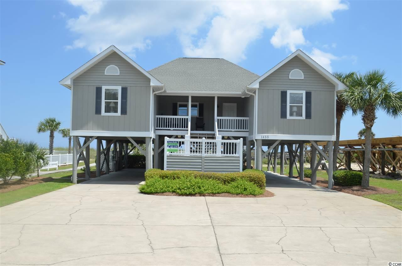 """Fishers of Men"" sits on one of the deepest 75' wide oceanfront lots in Garden City Beach.  This 7-bedroom, 7-bathroom home features a private heated pool and hot tub which helps generate excellent rental income.  Year after year, renters return to this cozy beach home as it's got that ""classic beach house feel.""  Contact the listing agent, or your Realtor, for the rental figures, more information or to set up a private showing."