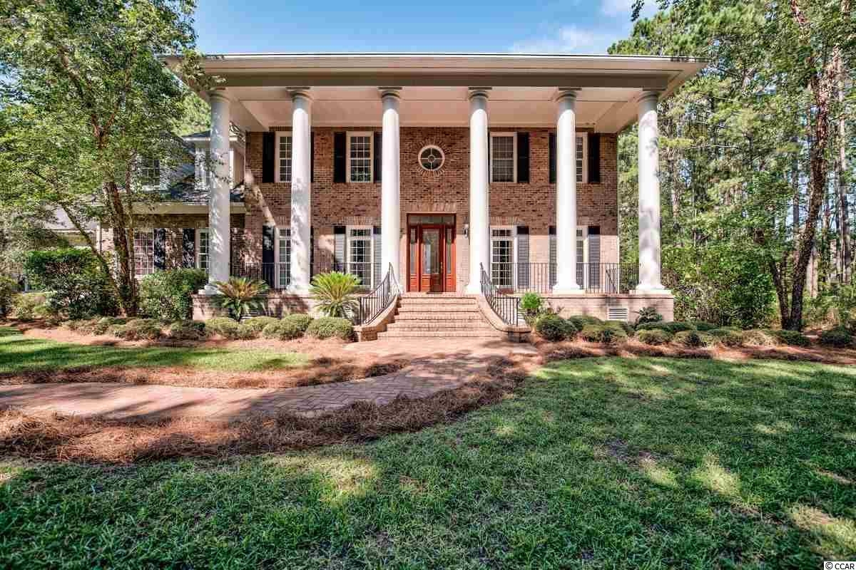 Georgian Colonial style 4 bedroom, 4 bath home overlooking a serene lake in the exclusive gated community of Prince George. Situated on over 2 acres this all brick home with stately columns on the front and double porches on the back  speaks southern style.  Sparkling hardwood flooring, formal and casual living and dining areas, master bedroom with fireplace, and a bonus/recreation room are just a few of the features of this home.  The welcoming fenced in backyard sports a refreshing pool and calming fountain, thoughtful landscaping and relaxing views of the private lake. This coastal community just south of Pawleys Island stretches from the river to the ocean. It offers a ten acre ocean commons area providing a recreational area  with tennis, basketball, bocce, croquet, shuffleboard, volleyball and horseshoes. The children's playground is just perfect for the young ones.  The spa and salt water pool lead to the Ocean Pavilion where a full kitchen, fireplace, and lakeside terrace provide the perfect spot to entertain.The river side of Prince George features a clubhouse and marina for the use of all Prince George residents. Prince George is a private gated community in Pawleys Island. Just over an hour to Charleston SC and thirty minutes to Myrtle Beach.