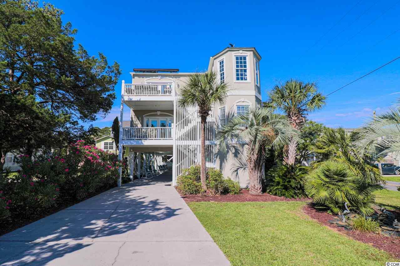 This stunning, upscale CORNER LOT BEACH HOUSE has everything you can ever imagine and more, including an ELEVATOR! LOCATED A MINUTE FROM THE BEACH!! This EIGHT bedroom, FIVE FULL baths, and one half bath features an elegant, bright, and open floor plan. This house has incredible rental potential with TWO completely separate living spaces! Live in one and rent out the other or rent both out! Quality and tasteful touches throughout with each level having separate kitchens, separate living rooms, and separate master suites! You can enjoy the amazing weather and beautiful views from several different balconies this house has to offer! With your own private pool, covered porch, and plenty of area to lay out & relax, this home is perfect for entertaining and family fun!