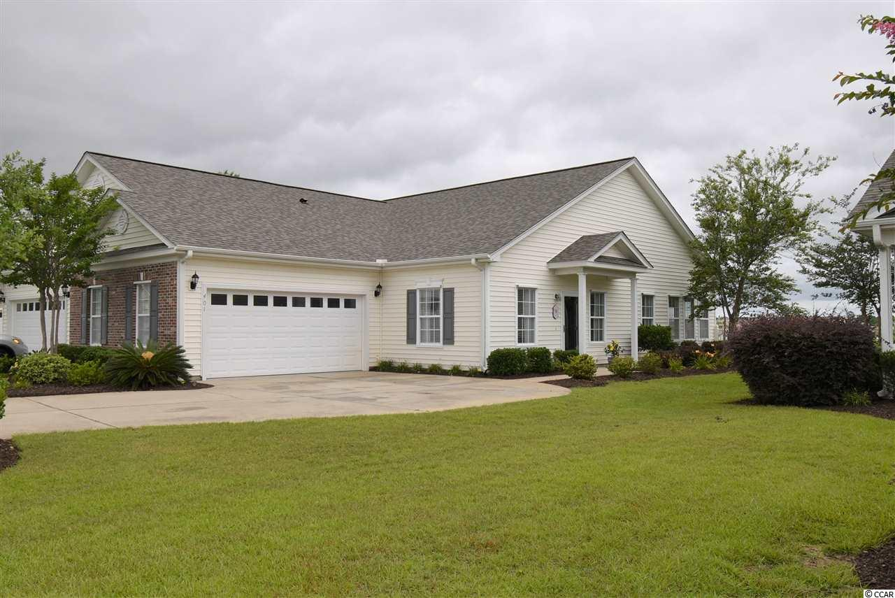 Immaculate 2 Bedroom, 2 bath, move-in ready Paired Ranch home located in Deerfield area, Surfside Beach (out of City Limits). Home has many upgrades, please ask your realtor to print upgrade list from associated docs on mls. Community Pool! This home has a Brand New Hot Water Tank, Hurricane shutters, Corian Kitchen Countertops, Double Pantry and 1 year old High End Samsung Refrigerator in Kitchen and a kitchen island! New roof in 2020! Master bedroom has large walk-in closet, linen closet and private bathroom with 2 sink vanity and garden tub/shower combo! Guest bathroom also has a garden tub/ shower combo. Fenced back yard (new owner can add small section between next door neighbor if they so desire... Yard is fenced but because the next door neighbor is a relative they did not add the separation fencing between the two yards... (new owner can add small section between next door neighbor if they so desire but must match existing- see hoa). New roof installed in February, 2020! Home also has custom Hurricane Shutters, beautiful back yard with Patio and Fencing. Quiet setting on the pond.  Home is a PAIRED RANCH...NOT a condo. HOA fee includes ALL exterior insurance of structure, all exterior maintenance (except doors and windows), landscaping & Lawn Maintenance (except inside fenced areas), irrigation, water & sewer, Basic cable, Internet, Trash pickup, Pest Control, Termite Treatment, Deerfield Links Drive & street light maintenance and Pool. Home has Hurricane Shutters that offer an Insurance Discount (see attached associated docs). Make an appointment to see this home today!
