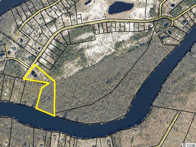 Nice lot to  be subdivided on Francis Marion Drive.  Lot is approximately 8.77 acres of land with plenty of space to build on the highland and river frontage along the Black River.  Property has a pond on the front and river access along the rear.
