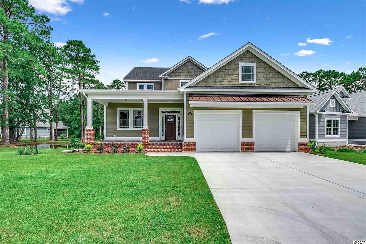 Beautiful custom home in Waterbridge, a premier gated Carolina Forest Community.  Come home every day to this well appointed 3 bedroom, 3 bath home to enjoy the tranquility and beauty of Waterbridge.  Enter through the elegant foyer to an office on your left (which could be a fourth bedroom).  continue to the open kitchen/dining/great room combination with delicate trim and ceiling features.  The kitchen offer abundant cabinetry, granite countertops and stainless steel appliances.  The master bedroom is located on the first floor with a tray ceiling and access to the back patio.  The master bath is complete with double vanities, granite countertops, a linen closet and access to a large walk in closet.  The rear patio overlooks a large backyard backing to a wooded preserve area.  The first floor is completed by a pantry and laundry room. The second story is home to two large bedrooms, a full bath and a spacious bonus room with a deck/balcony overlooking the backyard. Schedule your showing today!