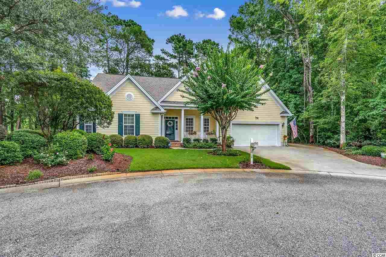 One story, 3 bedroom, 2 bathroom, Low-Country Home, located on the 2nd fairway of Pawleys Plantation Golf & Country Club, a Jack Nicklaus Signature Golf Course.  Private setting on a cul-de-sac, with unbuildable wetlands on the right and an unimproved lot to the left (which conveys with the purchase of this property).  Walk up to a low country, rocking chair front porch, and enter into the foyer leading to the formal living room area adjacent to the dining room.  Large great room and kitchen combination with a setting that welcomes family gatherings with many memories to be made.  Screened-In porch (10x27) with sliders and 2 ceiling fans, that can be accessed from the great room, formal living room, and large master bedroom, with views of the private back yard and the golf course.  Updates to include a completely remodeled master bathroom (2015) with separate custom made vanities with marble countertops, tiled shower with a bench, and ceramic tiled flooring.  Kitchen was updated in 2016 with Granite Counter Tops and all new stainless steel appliances (including a double oven, a 5 burner gas stove top, and wine cooler).  Plenty of cabinet and counter space, breakfast bar, eat-in area, and pantry as well. Other features to include wood flooring in all common areas of the home, carpet in all 3 bedrooms, ceiling fans with lights in all bedrooms, gas fireplace, irrigation system with well water, keyless entry to garage, and additional parking pad on right side of home.  Just minutes from local beaches, casual and fine dining, shopping, and other area championship golf courses.  Myrtle Beach is 20 miles north, Georgetown is 7 miles south, and Historic Charleston 70 miles south.  Pawleys Plantation Golf & Country Club information available upon request.