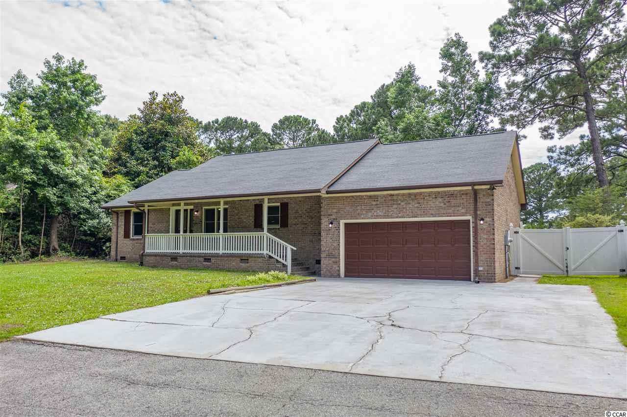 NO HOA FEES in this lovely, quiet neighborhood very close to beaches, shopping, restaurants, golf and boating situated less than 10 minutes from North Myrtle Beach.  This 3BR 2BA all brick home features a Carolina Room overlooking a large fenced in back yard and a recreation/bonus room that can be accessed from inside the two car garage. All walls and ceilings of home have been freshly painted.  The home has a new roof, new kitchen countertops, new fixtures, updated bathrooms, laminate flooring in living, dining, kitchen, sunroom and new carpet in bedrooms. THIS HOME IS BEING SOLD AS IS.