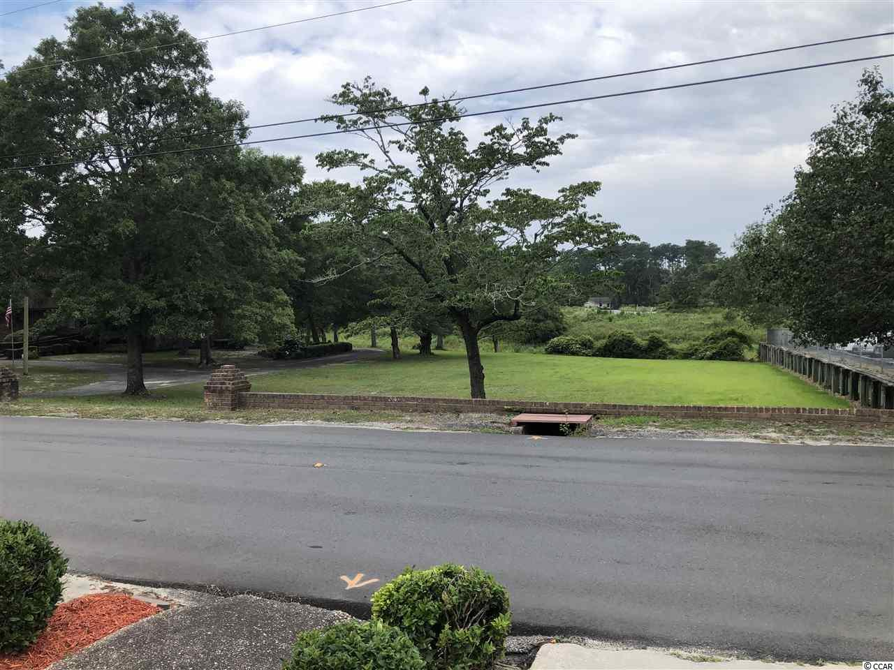 Beautiful lot a little over a quarter of an acre located just a few short blocks from the Intracoastal Waterway and just a short 10 minute drive to the beach.  The absolute ideal place to build your dream home free of any HOAs or cookie cutter subdivisions.  Take your golf cart or a short walk to all the waterfront dining and entertainment the waterway and Little River have to offer.  This lot backs up to a lake which offers a peaceful view and prohibits future building behind your new home.