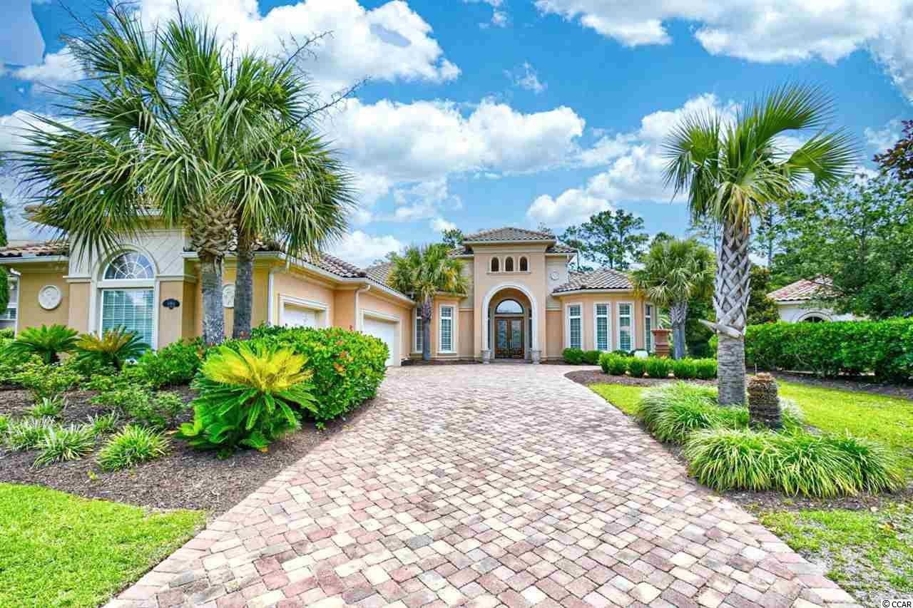 Welcome home to this luxurious 4 bedroom, 3.5 bathroom ICF construction home located in the quiet, gated community, The Calais at Grande Dunes. As you enter, you will immediately notice the tall tray ceilings and luxurious wood flooring flowing throughout this 5000+ sq. foot home, along with unique light fixtures, chandeliers, and a grand fireplace in almost every room. The kitchen is equipped with stainless steel appliances including double ovens, granite countertops, and a huge breakfast bar and breakfast nook, separate from the formal dining room. The master suite includes a tiled walk in shower, an oversized jetted tub as a main focal point, marble flooring with double vanities, a wet bar, and two walk in closets. Each bedroom continues the tray ceilings, offers plenty of closet space, and easy access to a bathroom. Enjoy time with the entire family in the two living areas, or relaxing in the heated pool and hot tub in the back! A study/office and a washer/dryer included with sale adds even more convenience to this already, move-in ready home. The Calais at the Grande Dunes offers the best amenities, including a pool, tennis courts, clubhouse, oceanfront cabana, two golf courses, onsite dining, restaurants, private marina, and so much more. Located a short walk or golf cart ride to the ocean, and near all of Myrtle Beach's finest shopping, dining, and entertainment attractions. You won't want to miss this one! Schedule your showing today!