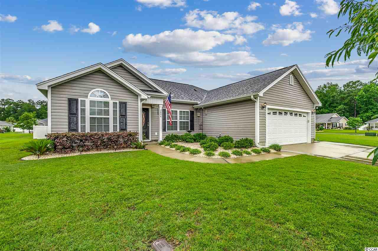 A beautiful 3 bedroom, 2 bath home in the desirable Macala Acres subdivision in Conway, SC with low HOA fees.  This home has been well-maintained and features cathedral ceiling in the living and dining area along with chair railing.  It is also wired for surround sound for a better TV viewing experience.  The kitchen has a great breakfast bar that seats 4 people, stainless steel appliances, pantry and a Delta No Splash Faucet.  The spacious Master Bedroom features a tray ceiling, remote controlled lights and fan with a large walk-in closet and ensuite bathroom.  The Master Bath has a garden tub and shower with double sinks.  There are 2 extra bedrooms and a bathroom with a separate linen closet in the hallway.  The sliding glass door opens up to a spacious patio that has footers in place for a future screened-in porch or Carolina Room.  Enjoy entertaining with family and friends around the fire pit in your spacious backyard.  This home sits on a large well maintained corner lot with French drains.  There is an access door from the garage to the side yard where you will find hot and cold water spigots for cleaning your car or pressure washing your home.  The garage offers plenty of storage, 80 gallon water tank and a utility sink for easy clean up before coming inside.