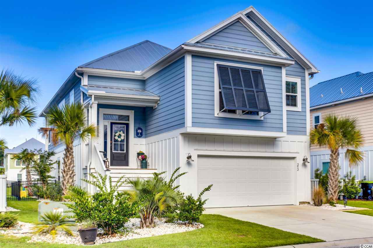 "Raised Beach Cottage~3 bed/2.5 bath located in Wildnerness Pointe in the Prince Creek area of Murrells Inlet. The Summerlin layout is the largest floor plan built in Wildeness Pointe providing you with ample room. The first level of this amazing home features a game room/second living area with a bar, 2 guest bedrooms and shared full bath, a covered porch with extended patio and fenced in back yard bordering the community lake. On the upstairs level you will find your main living area and spacious kitchen with an oversized island as well as custom home/office with built ins. Upgraded stainless appliances, beautifully tiled backsplash and pantry. The spacious master suite is also on this level and features a tray ceiling, walk-in closet, master bath with luxury tiled shower, double vanity and private water closet. Other features include 9' tall ceilings, metal roof, built in speakers, irrigation, natural gas tankless renai hot water heater, touchless faucets, & Bahama shutters to carry the ""resort-style beach home"" look and feel. The HOA includes a great amenity area with a large pool, kids playground, basketball, tennis, pickle ball, bocce ball and covered pavilion area with tables and restrooms. Just minutes away from the Murrells Inlet Marsh walk, famous seafood restaurants and inlet views, Brookgreen Gardens, fishing piers, Huntington Beach State Park, beautiful beaches and so much more! A must SEE with Tons of UPGRADES!!"