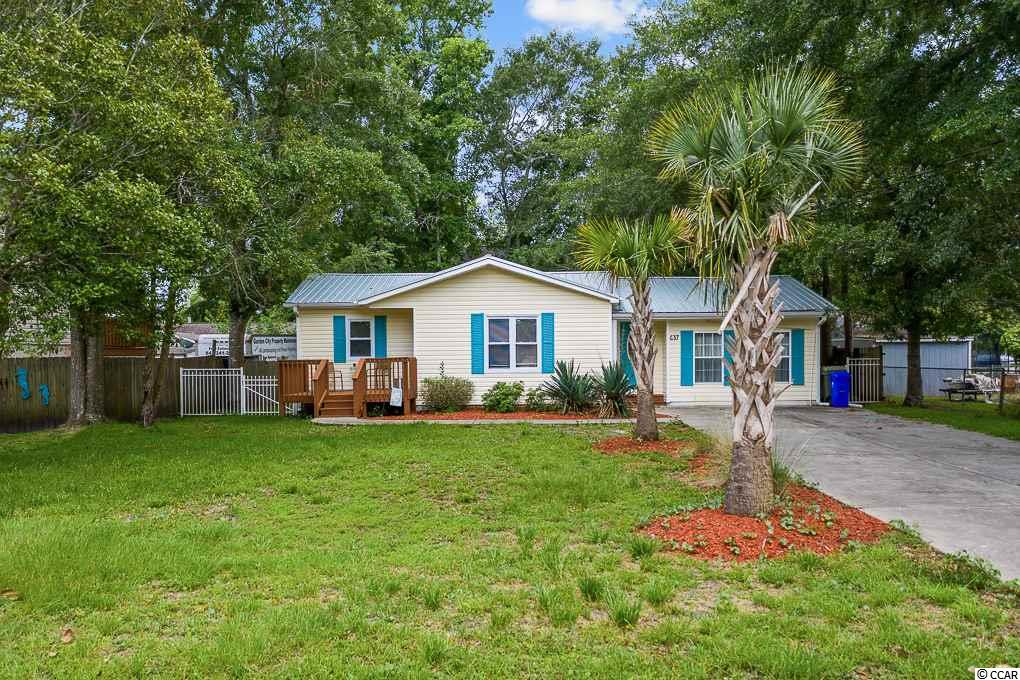 Ready to make your move to the beach?  This well-maintained move in ready home is truly a rare find in the highly sought-after Surfside Beach area! Bring your golf cart for a short 5 block ride to the ocean.  Located on the East side of Highway 17 Business this 3-bedroom 2 bath home has new paint throughout, crown molding, back-splash in the kitchen, and new laminate floors throughout the bedrooms and living area.   This home features a large master bedroom suite with a large walk in closet. Some additional amazing features of this home include; new metal roof installed in 2017, large fenced in backyard, screened in porch, and newly stained front deck.  No HOA and excellent location for everything Surfside Beach has to offer! ****Open House Saturday, June 27th and Sunday, June 28th from 1-3 ****