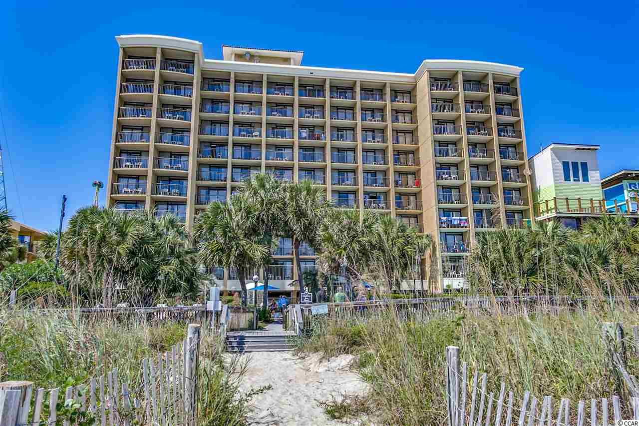 Beautiful oceanfront one bedroom, one bathroom condo in Holiday Inn at the Pavilion Resort! This 8th floor unit features upgraded maple cabinets, granite counter tops, black appliances and furnishings. As you enter there are two beds and a closet area that is separated from the living area by the galley kitchen and bathroom. Gorgeous direct oceanfront views await you in the living area that includes a Murphy bed for additional sleeping, a pull-out couch, sitting areas, and a dining table for entertaining guests. The kitchen offers a full-size refrigerator, stove, double sink area, and microwave. The ocean views are endless from the balcony where you can sit and relax for hours listening to the sound of the waves and feeling the ocean breeze. You have views of the pier, the sky wheel, and miles of boardwalk to enjoy. The endless amenities include an outdoor pool, indoor pool, lazy river, kids play area, and hot tubs. You can also find a tropical beach bar, business center, and fitness room on property. Everything is at your fingertips, and you are just minutes from the best shopping, dining, entertainment, and attractions that the Grand Strand has to offer!   Don't Delay!