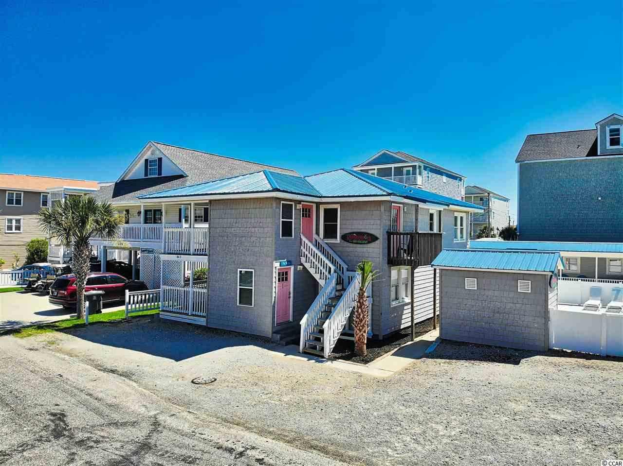 "This home called ""1 By The Sea "" is directly across the street from the Ocean on a Corner lot, has an in-ground pool out front. This is a 7 bedroom, 6 bath 2 story home with spiral staircase that will accommodate approximately 26 people. New Kitchen, New Living Room Furnishings, Paint, Landscape, Has Metal Roof, Ready to rent or Excellent 2nd Home. SQUARE FOOTAGE IS APPROXIMATE AND NOT GUARANTEED. BUYER IS RESPONSIBLE FOR VERIFICATION."