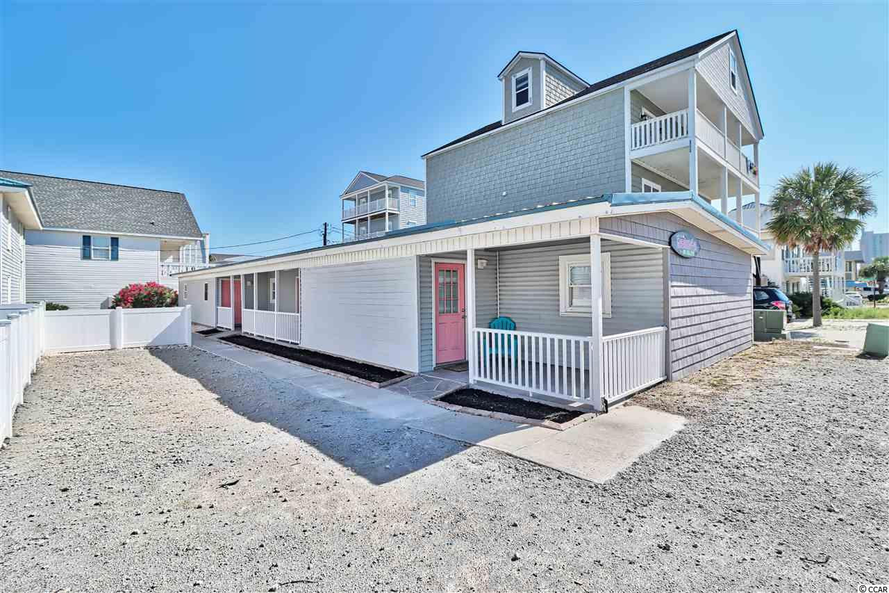 "This home called ""2 By The Sea "" is directly across the street from the Ocean. This is a large single family 6 bedroom 4 bathroom home, can be used as a Single Family, Duplex or Triplex and does have 3 electrical Meters. with lock out options. Will accommodate approximately 24 people. New Kitchen, Updated Furnishings, Paint, Landscape, has Metal Roof, Ready to rent or Excellent 2nd Home. Guests can appreciate a short drive to great restaurants, ample shopping and entertainment. The Pool goes with the Adjacent Property not this property.   TO FURTHER CLARIFY THE USE THE ENTIRE PROPERTY IS CURRENTLY USED AS A SINGLE FAMILY AND HAS ACCESS FROM ALL THREE EXTERIOR DOORS AND AS WELL AS IT HAS INTERIOR DOORS WITH LOCK OUT OPTION SHOULD YOU WANT TO USE IT AS A TRIPLEX OR EVEN A DUPLEX.  YOU HAVE THE OPTION OF USING THIS PROPERTY AS A SINGLE FAMILY, DUPLEX OR TRIPLEX.     SQUARE FOOTAGE IS APPROXIMATE AND NOT GUARANTEED. BUYER IS RESPONSIBLE FOR VERIFICATION."