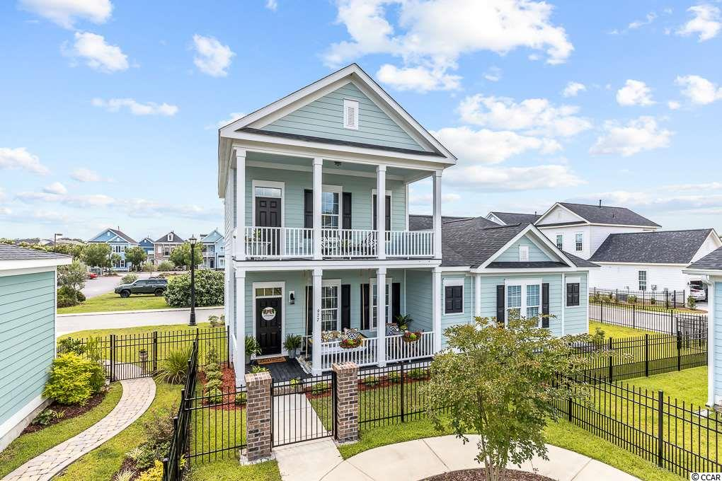 Incredible 3BR/2.5 BA in the desirable Downtown District area of Market Common know as The Battery.  The Battery is a charming Charleston-Style community reminiscent of historic and coastal southern architecture and character with walkable streets and exceptional curb appeal.   Rock or swing your day away from the double  stacked front porches, each 21'10'' x 8'0''. The custom handmade Swing Bed with Sunbrella cushion conveys on the bottom front porch and is sure to be a popular gathering place and lovely welcome area  . This  Berkley floor plan offers a luxurious  1st Floor Master Suite with large walk in closet, trey ceiling, glass and tiled walk in shower w built in bench and a granite double sink vanity.   This open floor plan is perfect for entertaining, and with 10' ceiling, ample moldings and dining area,  its the perfect place to cook and interact easily with family or guests.  The well appointed kitchen has granite counter tops, gas stove,  SS appliances, breakfast bar,  and a huge walk in pantry.   Pendant lights and recessed lighting warm this living space and highlights the beautiful wood flooring.   The stairwell leads you upstairs to 2 ample bedrooms with a large shared bathroom and double sink vanity.   The side yard on this corner lot awaits your stylish touch.  The rear load 2 car garage is accessed from a quiet alley.    Just a short walk or golf cart ride to casual dining, coffee shops, movies and many other attractions.    Serene parks and lakes are here for you!    Just minutes to the beach and airport, don't miss Myrtle Beach's first urban village by the sandy shores.  3D Virtual Tour availible