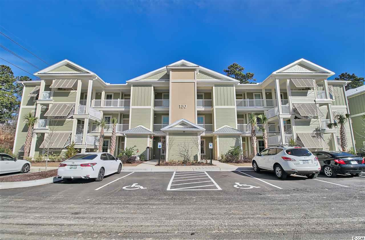 "Located in the heart of Pawleys Island, this condo offers easy and convenient coastal lifestyle living. An affordable opportunity to have your own place at the Beach. Elevators and a pool, hardwood floors, granite countertops, and a screened porch are a few of the details you'll love! While being located near public tennis courts, a fitness club, shopping and dining, you are also only a short drive to the beach, the river, golf courses, marches and marinas. This home offers all that you are hoping for in a SC beach community. Photos are from a 3 bedroom corner unit in a previously built ""sister"" condo community in Pawleys Island. This unit includes an upgrade package featuring Stainless Steel Appliances, Granite tops in baths, Laundry room cabinets and crown molding in main living areas."