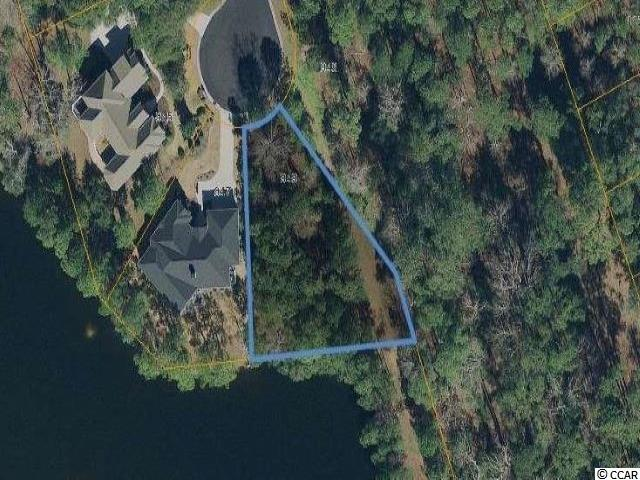Amazing opportunity to own a MASSIVE LOT in the exclusive Bluffs section of Tidewater Plantation in North Myrtle Beach! This private home site is .40 ACRES, located at the end of a cul-de-sac, with a golf course view, ON GORGEOUS Pintail Lake, and next to HOA owned land for maximum privacy. Property has utilities in place and ready to go! No time frame to build and bring your own builder. World-class amenities include: manned 24 hour guard gate, Olympic-sized swimming pool, private Bluffs section only pool, bocce ball area, gazebo, award winning golf, fitness center, and a private Ocean front beach cabana just minutes away! You won't find another location like this one, Call TODAY!