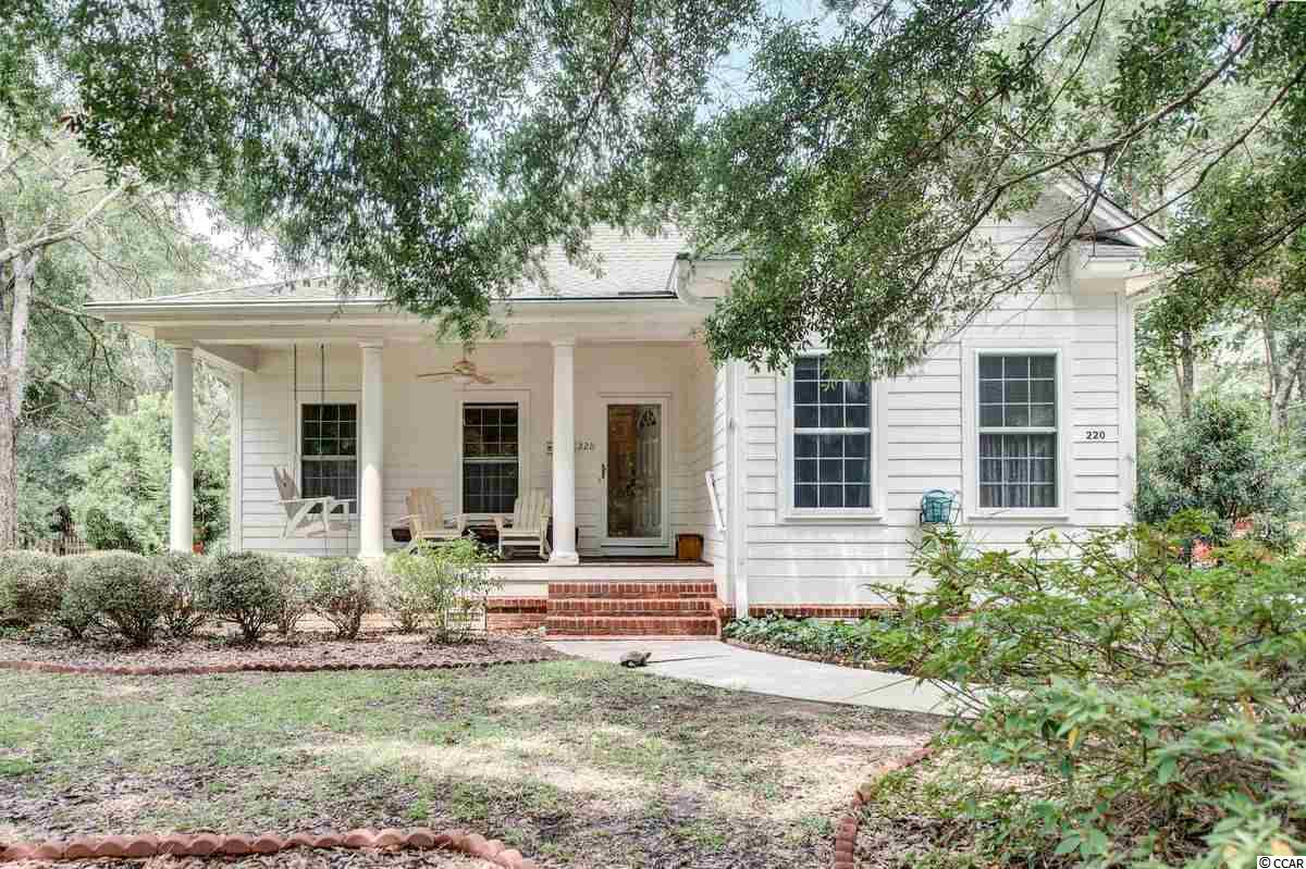 Charming Custom built home, with open floor plan, located in the Bluff's Subdivision of Pawleys Island, SC. A desirable Coastal designation. Short distance to the Marsh and beautiful Beaches of the Atlantic. This Cottage style home features 3 Bedrooms and 2 full Baths. Red brick steps lead to a large front porch, with swing, for cool summer evenings. Formal Living and Dining area with hardwood floors, fireplace, tray ceiling, crown molding, recessed lighting, and ceiling fan. The Kitchen features hardwood floors, granite counter tops, breakfast bar, crown molding, propane gas stove top, electric oven, dishwasher, and newer microwave. The Kitchen also leads to a screened porch and patio. The Master Bedroom features a tray ceiling, ceiling fan, recessed lighting, and leads to a private second screened porch. Master Bath with vanity, walk-in shower, linen closet, and large walk-in closet. All bedrooms have newer vinyl flooring. Attached 2 car, side loading, Garage with work bench and utility sink. Pull down Attic. Hardy Plank Siding. Outside Shower. Screened split rail fencing. Low HOA fees. Enjoy a Low Country Life Style and all it has to offer. Fine dinning, boutique shopping, golfing, fishing, kayaking, crabbing, and sandy beaches. Approximately 30 minutes north to Myrtle Beach and 75 miles south to the historical city of Charleston, SC. Verification of all HOA documentation and the square footage of the house are the responsibility of the Buyer (s).