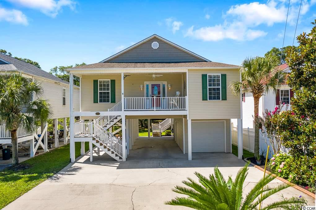 This 4 bedroom beach bungalow is located just minutes from the ocean front. The location showcases many of the great things Cherry Grove has to offer. The home features tile flooring throughout, 4 spacious bedrooms, 3 full baths and ample storage, all with an island inspired warmth. Ceiling fans in all bedrooms and living areas of home..  Watch the sunrise over the quaint pond located just off of your over sized rear deck. Enjoy sipping your favorite beverages of choice watching it set from your front deck. In ground irrigation system keeps your landscaping looking beautiful, and low voltage out door light enhance those romantic summer evenings. Under the home is perfect for family gatherings, hammock lounging, and fun cookouts in the summers or oyster roasts in the fall. The lot is also large enough to add your own pool.  Located just a golf cart ride to all North Myrtle Beach has to offer....Shopping, restaurants, and most importantly , the beach...You need to make this your first stop. You'll be so glad you did.