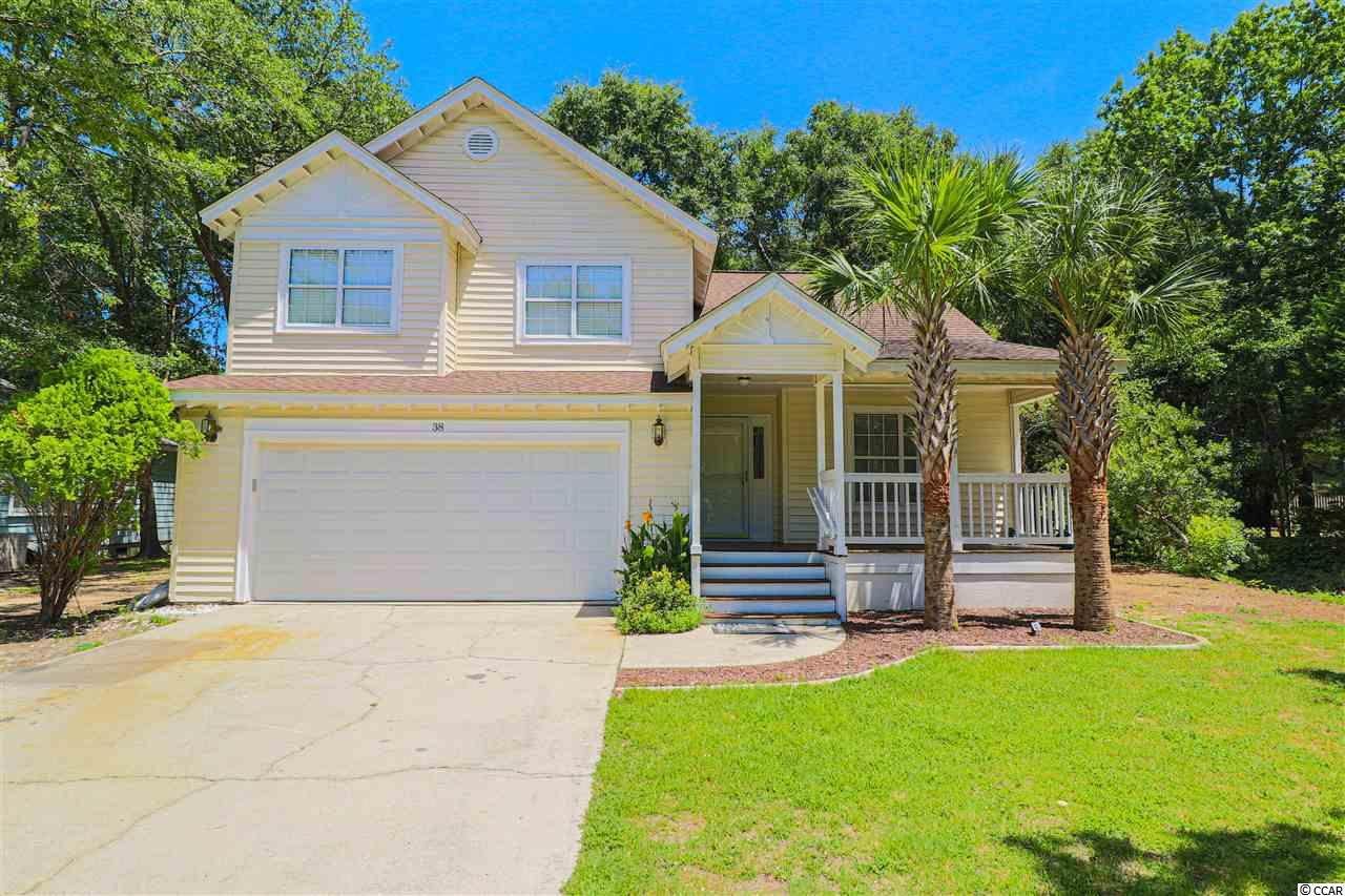 Move-in ready, golf cart distance to the beach, and east of 17 in Pawleys Island? Yes! This 3 bedroom, 2.5 bathroom home is located off S. Causeway Rd. and is less than a mile away from the beach. This beautiful home is on a large corner lot giving you extra privacy. Inside the home, you'll notice new flooring, new paint, new appliances, and new light fixtures throughout. The master bedroom features a vaulted ceiling and two walk-in closets. Once you walk into the master bathroom, you'll be delighted to see dual vanities, a whirlpool tub, and separate shower. The HVAC is only 3 years old and the roof is only 5 years old. Come schedule a showing today!