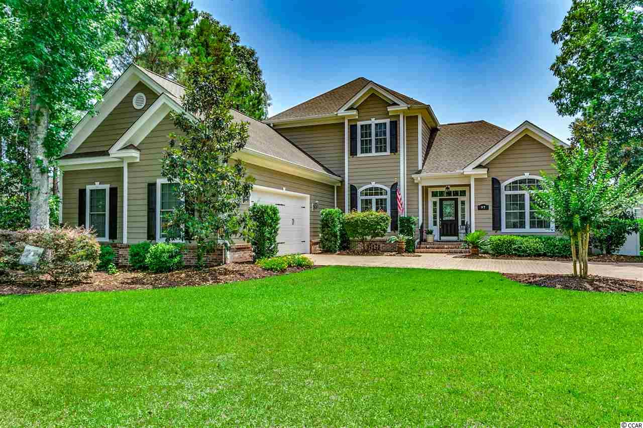 """Come, relax and enjoy the spectacular lake views this home has to offer from both levels.  97 Highwood Circle is located on a large 1/2 acre home site in the gated upscale community of Highwood at Prince Creek at the TPC of Myrtle Beach golf course. As you enter the foyer you will see this home is in immaculate condition! The living area has NEW hardwood floors and a double sided fireplace for those cool mornings. Off the living area is a beautiful sunroom with 18"""" tile floors where you can relax and enjoy the lake view or venture out onto the trex deck.  The deck area is complete with awesome views and natural gas hook-up for your grill. The elegant master bedroom has a double trey ceiling, large en-suite bath, double vanity with granite tops and tiled walk-in shower.  The kitchen has 18"""" tiled floors, stainless appliances, natural gas range, granite counter tops, cherry cabinets and a large island.  Each of the guest bedrooms come with amazing views and each has it's own bath complete with granite vanity tops.  Three brand new A/C units, over sized garage with workbench, irrigation (well) system, large laundry room, cedar closet and brick paver driveway are all added bonuses! Frig in garage stays as well as the grill on the back deck. Located only a few miles from the Waccamaw hospital, the Murrells Inlet Marshwalk, restaurants, shopping and numerous golf courses.  Schedule your appointment today!  When you visit this home, it will feel......like home."""