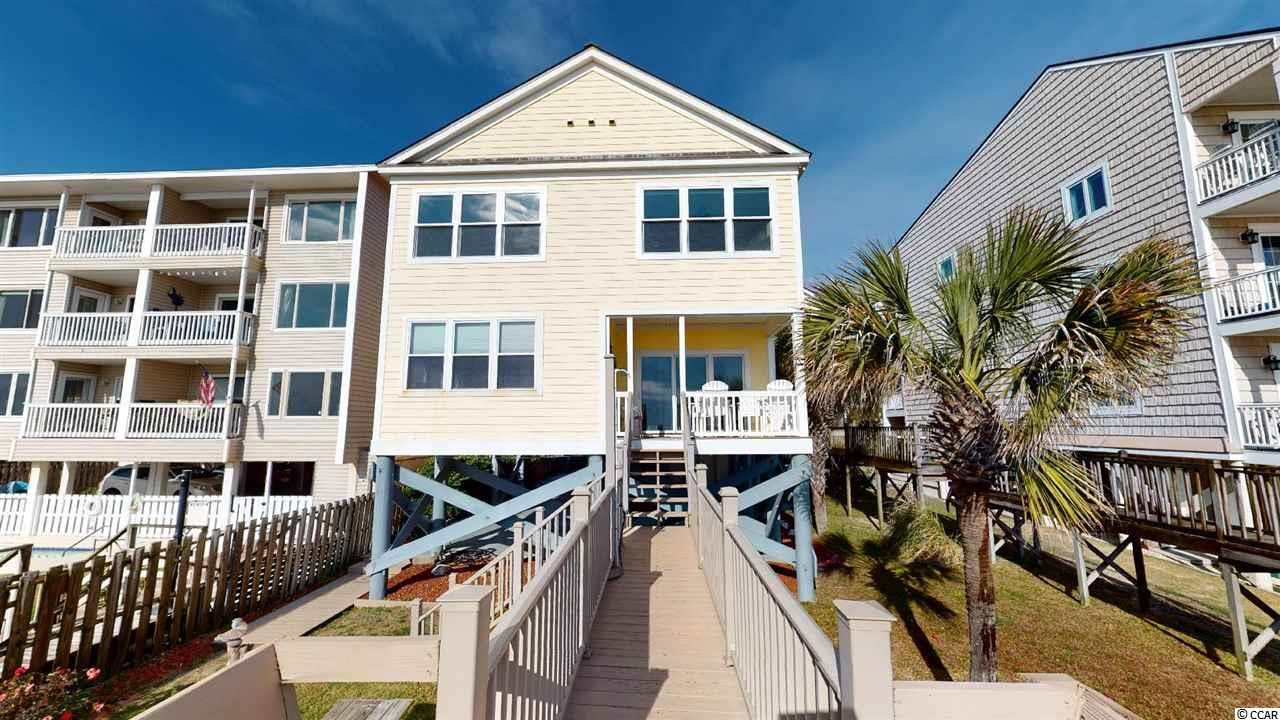 Enjoy Newly Remodeled Oceanfront Home in Beautiful Surfside Beach! New paint, new décor, new light fixtures, New Bedding, Hardwired Ceiling fans. Enjoy beautiful Surfside Beach. Her name is Bella Alba ( Beautiful Sunrise).  Enjoy all that Surfside has to offer, sidewalks, walking to the Pier and restaurants. Enjoy our parks, library , baseball fields and water lagoon. Property comes furnished with new luxury vinyl and new den furniture. One bedroom on master floor with 3 large bedrooms upstairs! (2nd floor) 3 bathrooms are privately located in bedrooms! Enjoy your oceanfront home from you private porch and walk to the beach on your private walkway to beach with private shower. The luxury outdoor composite furniture comes with a lifetime warranty! Your new home has a BRAND NEW electrical panel($$$) Home also has NEW luxury vinyl on first floor! Metal Roof installed 2016. AC is only TWO YEARS OLD. This is truly a dream home.  Bella Alba has an excellent track record as a very profitable investment! Priced to sell! All measurements are responsibility of buyers agent and buyer.
