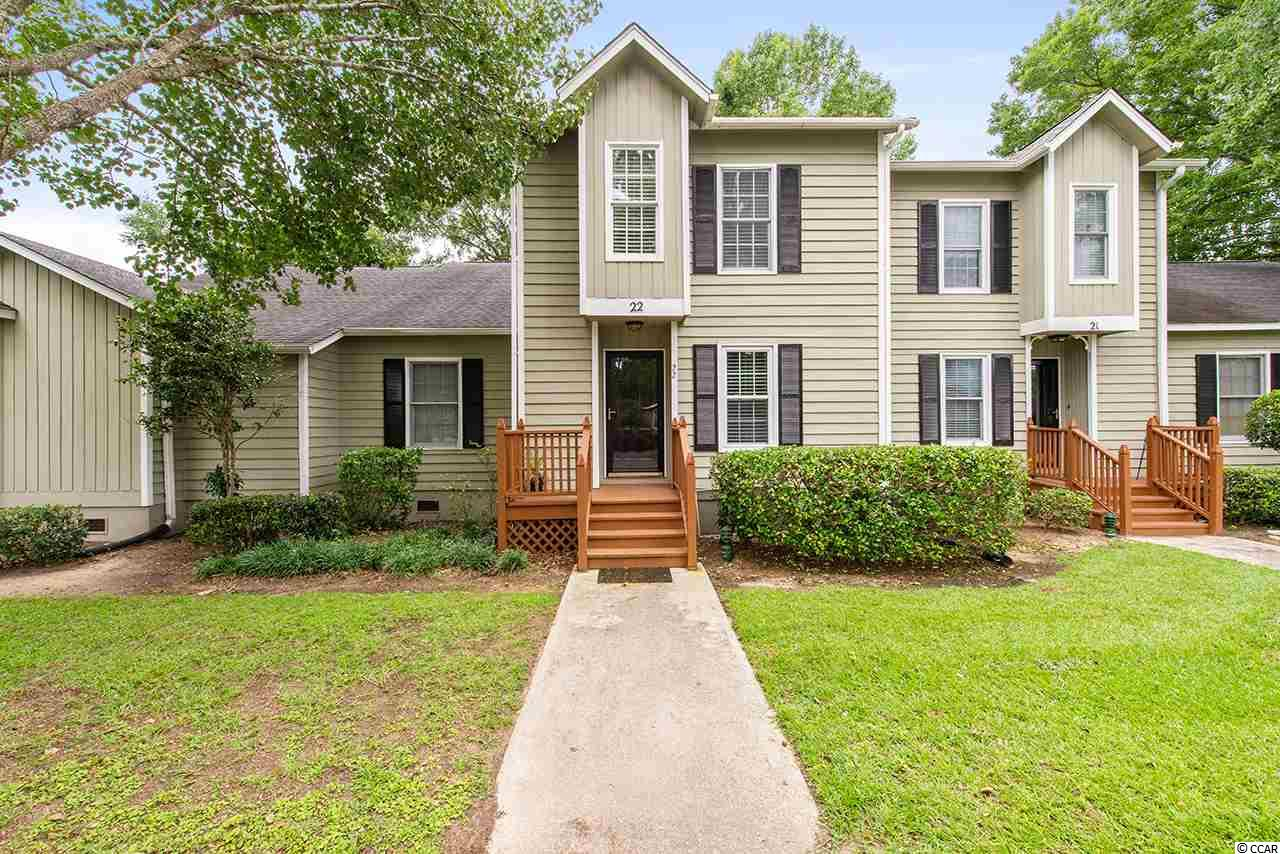 Moss Creek is a beautifully designed town home community located in Murrells Inlet with mature landscaping and live oaks trees nestled in a park like setting, within walking distance or bike ride to many of the areas finest seafood restaurants and close proximity to Huntington Beach State Park, Waccamaw Hospital, Brookgreen Gardens. For starters, 4840 Moss Creek Loop 22 has new wood floors and sub flooring on first and second floor. (no carpet) The Kitchen: Quartz tops, Stainless Appliances, stainless stove hood, upgraded dishwasher, disposal, abundant cabinets, storage, all doors, drawers soft close, tile floor, upgraded stainless sink and plumbing fixture, recessed and under cabinet lighting, subway tile backsplash, comfort height quartz breakfast bar, cubby for microwave and movable prep table, open to Dining and Living areas. All light switches converted to rocker style. Added functionality to Living Room with a wall of built in base cabinets and bookcases.  Upgraded French doors and new threshold opens to rear deck from Living Room and view of Tennis Courts, Community Pool, Fountain in your backyard. 36 square feet of enclosed storage for beach, fishing gear, golf clubs, bicycles, tools. Laundry room on second level with full size washer, dryer. Each bedroom (14x11) has ensuite. All front and rear decks replaced, building painted. This town home never rented, never smoked in, no pets. Each unit has 2 parking spaces. This is the second owner. Enjoy the afternoon shade and afternoon ocean breezes at Moss Creek Murrells Inlet.