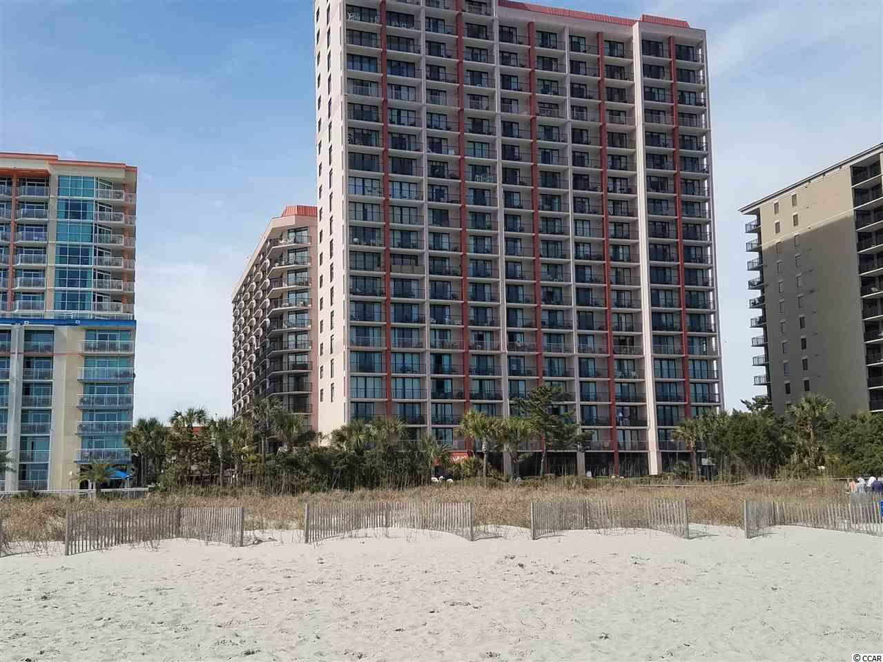 NO HOA FEES UNTIL 2021. SPACIOUS ANGLE OCEANFRONT 2 BR CONDO RECENTLY REMODELED WITH LVP LUXURY VINYL PLANK FLOORS with 6 INCH BASEBOARDS, NEW FURNITURE, KITCHEN APPLIANCES and HVAC. A LARGE COMFORTABLE LIVING ROOM/DINING AREA WITH A WRAP AROUND TILED BALCONY. GRANITE COUNTERTOPS THROUGHOUT THE CONDO, UPGRADED KITCHEN CABINETS. MICROWAVE, STOVE, REFRIGERATOR, DISHWASHER. FRESHLY PAINTED and REDECORATED WITH LIGHT FIXTURES, WALL DECORATIONS and DRAPES. ADJACENT PARKING GARAGE with  WALKOVERS ON LEVELS 3, 4, and 5. THIS POPULAR RESORT IS LOCATED ON THE GOLDEN MILE OF MILLION + DOLLAR HOMES AND OFFERS INDOOR & OUTDOOR POOLS, LAZY RIVER, SAUNA, EXERCISE ROOM, CAFE & BAR, CONFERENCE/ DINING ROOMS. OWNERS MAY HAVE PETS. EASY ACCESS TO  CAROLINA BAYS PARKWAY (HWY 31), MYRTLE BEACH VENUES, AIRPORT & GOLF. AN EXCEPTIONAL VALUE FOR A FAMILY RETREAT. THE CONDO'S ELECTRIC POWER BILL IS INCLUDED IN THE HOA FEE. PRICED BELOW THE COMPETITION AND READY TO GO.