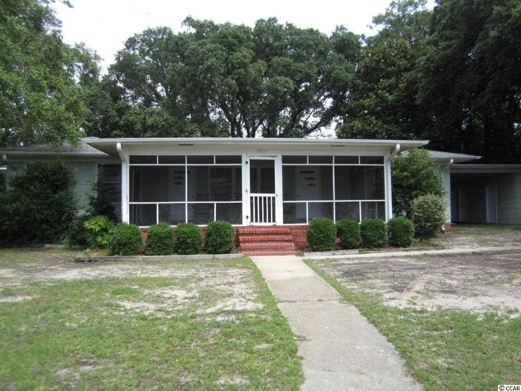 If these original paneled walls could talk, the memories they would share!  Own this Beach home and start building your family memories .  Great location in the Avenues section of Myrtle Beach and good ocean views from the home.  No HOA fees and this home is zoned for weekly rentals so it is an income generating property when you are not using it.  Roof is only 5 years old. This home is only steps to the Beach and has a large lot.   2 outdoor showers in the carport.  Enjoy the cool beach breeze on the 24 x 13 front screen porch or the 22 x 13 back screened porch.    Measurements are approximate, Buyer to verify.