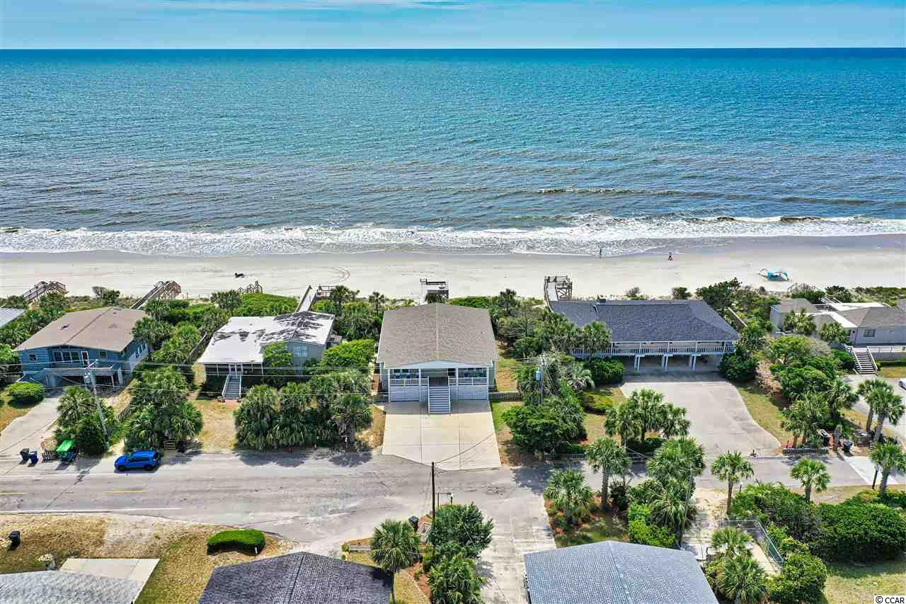 "Oceanfront beach house located on the desirable southern end of Litchfield Beach. Completely remodeled in 2016, this 6 bedroom, 5.5 bathroom home is the perfect spot for family gatherings or entertaining friends.  The kitchen and dining room has plenty of space for a large dining table and includes an oversized paneled refrigerator, wet bar and two wine chillers.  The entire house has easy to clean, scratch resistant flooring and all bathrooms include granite countertops.  There is an abundance of storage space underneath the house including additional parking.  Enjoy all of the outdoor living spaces which include a downstairs sitting area, a sun deck and a screened-in spacious oceanfront porch.  Downstairs is a ""suite"" with a bedroom, 2 bathrooms and a living area (which could easily be a 7th bedroom).  Included with this home are endless memories, evening porch stories and morning sunrises over the Atlantic.  If you are looking for a relaxing beach lifestyle, this is the home for you!  Litchfield is located just 70 miles for a day trip to historic Charleston, SC or 25 miles to the attractions of Myrtle Beach."