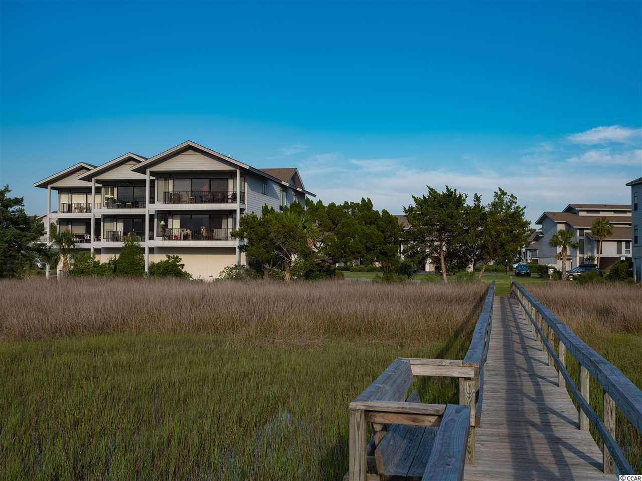 "Inlet Point is an exclusive tropical private gated oasis at the south end of Litchfield Beach, stretching from the Atlantic Ocean to the saltwater creeks and marsh. Litchfield Beach is known as the ""Golden Curve of the Grand Strand"" ! Named so for it's gently curving stretch and beautiful golden appearance created by the sun-kissed beach and by the golden yellow sea oats that grow wild in the dunes ! This fabulous second floor 3 bedroom, 2 bath villa sits overlooking the expansive marsh and creeks. Present owner has owned villa for almost 30 years. Huge 23'x14' garage storage room for beach and fishing gear. Peaceful relaxing picturesque sunsets daily ! Right next to the community boardwalk and dock. The beach and ocean are just steps away. Other amenities include a clubhouse, swimming pool and 24 hour manned security gate. Endless family fun on the beach and in the creeks enjoying God's abundant wildlife and nature ! Biking, jogging, walking and golf carting through the well landscaped grounds. Golf, shopping, restaurants. the Intracoastal Waterway and Brookgreen Gardens are all just about five minutes away ! Come enjoy all that Litchfield Beach has to offer !"
