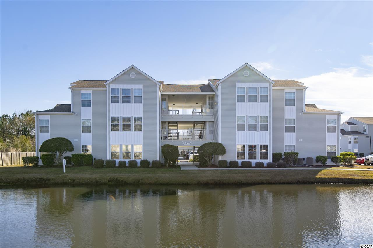 Located in Surfside Beach, this well maintained, first floor, 2BR/2BA condo offers beautiful lake views and a Carolina room.  Weekly rentals are allowed!   Southbridge is located just a few miles south of Myrtle Beach and a few miles north of Murrells Inlet which makes it convenient to everything the South Strand has to offer including the Murrells Inlet Marshwalk, Garden City Pier, Market Common, Myrtle Beach International Airport, restaurants, world class golf, and of course the blue Atlantic.  There is also a community pool for guests and residents to enjoy.  This condo makes the perfect investment property or second home.  Information is deemed reliable.  Buyer responsible for verification.