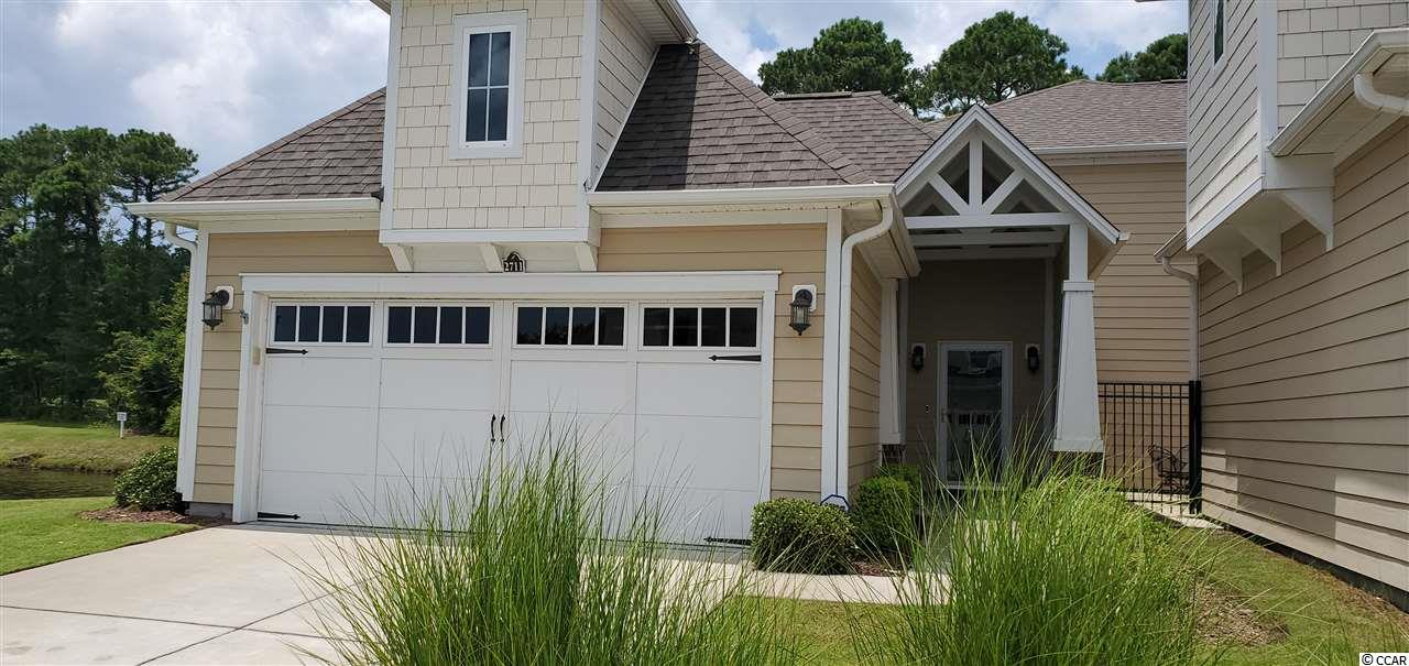 What a great location in Barefoot -This upgraded End unit is located next to the pond and backs up to the Norman Course. This home offers 4 bedrooms, 3 full baths along with a Heated/AC Carolina Room. There are multiple upgrades to this home that include Full Wall Custom Bookcase surrounding the Fireplace, Hardwood staircase, wrought iron railings, custom woodwork and crown moldings throughout. Wood floors throughout the first floor, oversized custom pantry, new kitchen granite , ceramic backsplash and cabinets in the garage with epoxy floors and a pulldown stair for access to added storage. This home has a transferrable Golf Membership to the Barefoot Courses. This home is a must see!